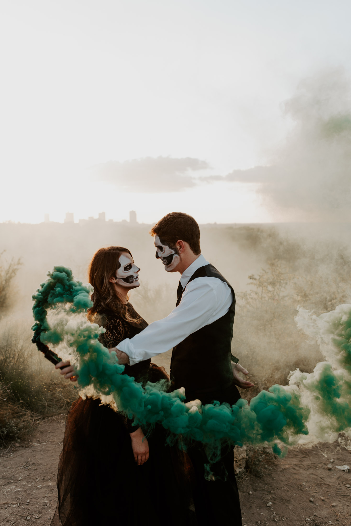 boy holding green smoke bomb for halloween themed photo shoot