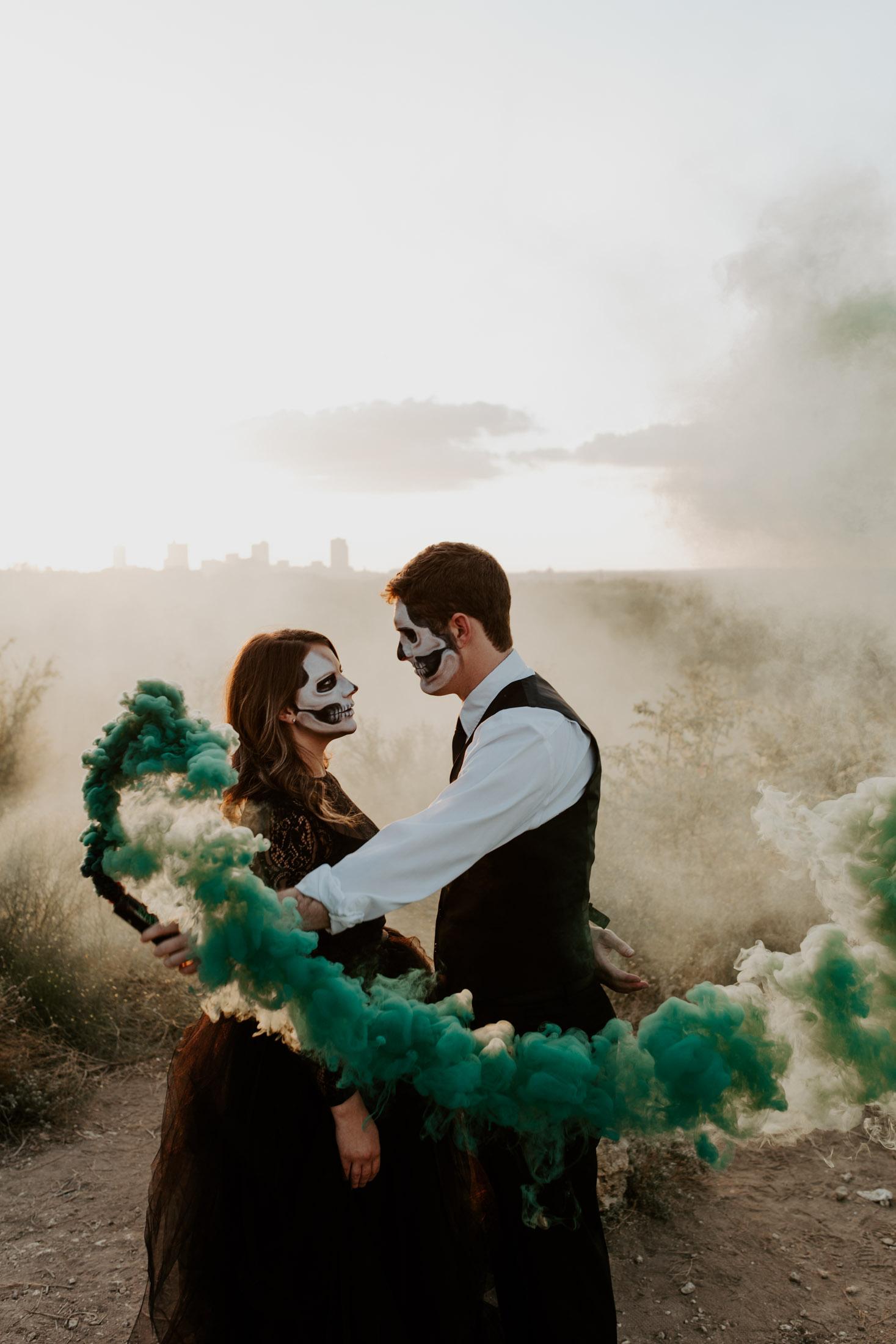 boy holding green smoke bomb for halloween themed photo shoot