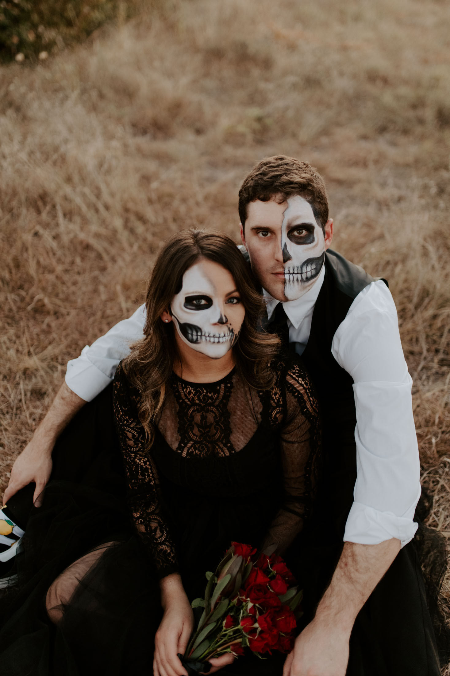 skull makeup faces looking at the camera during a spooky themed photography session