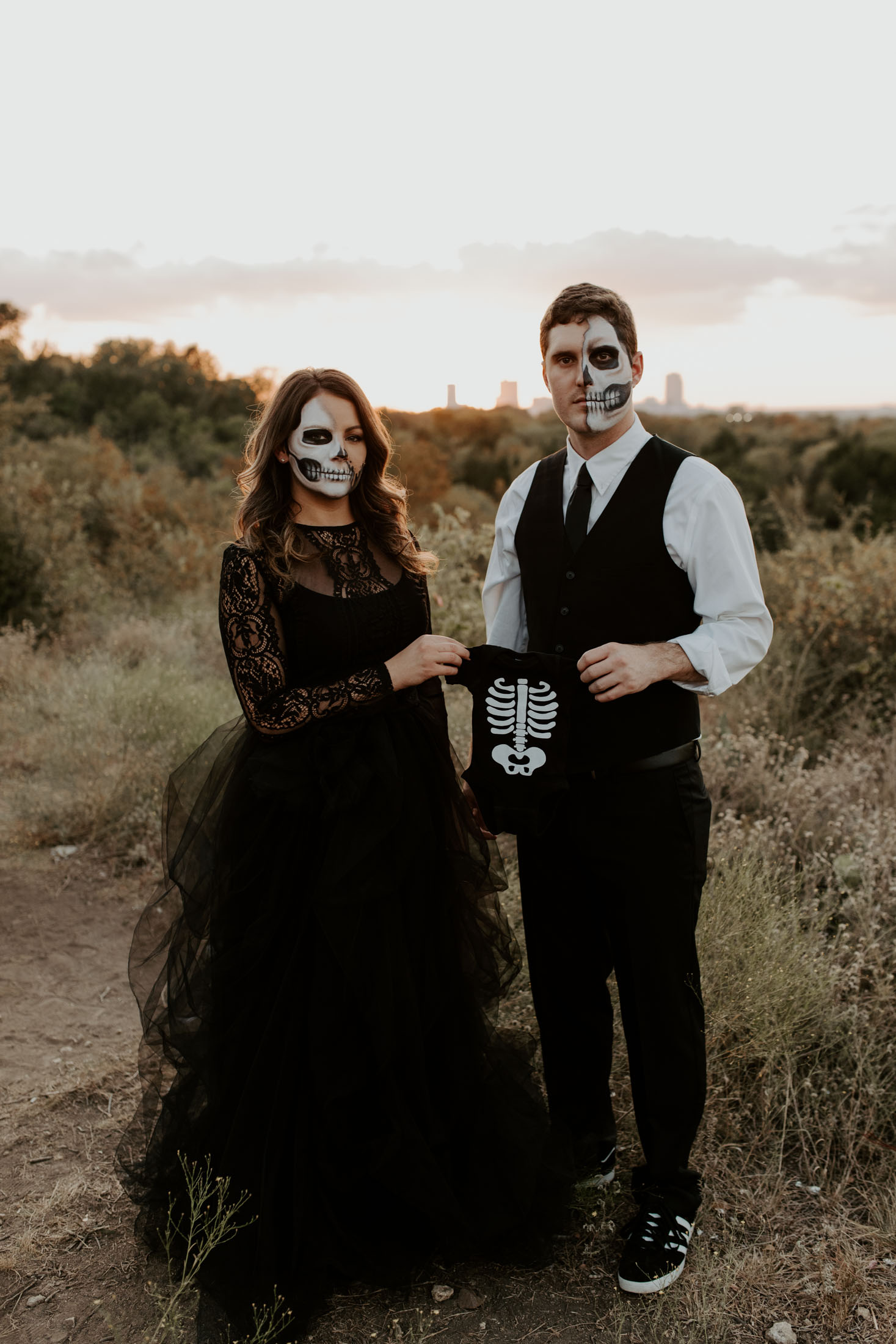 halloween themed couples baby announcement wearing skull makeup