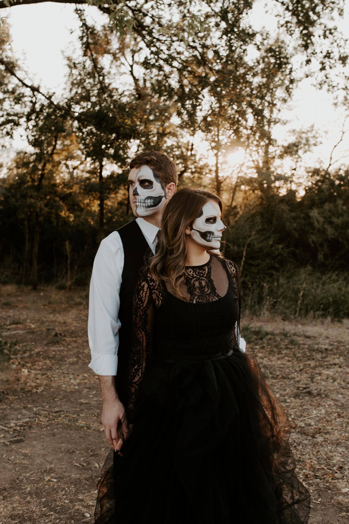 halloween couple looking in two different directions for a spooky shoot