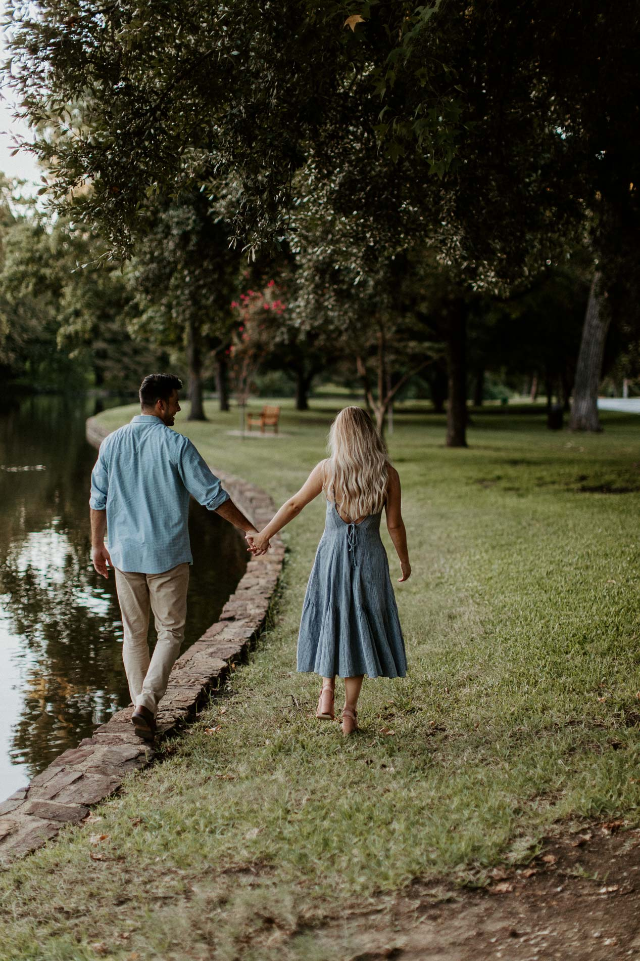 Couple holding hands during their engagement session in a beautiful location