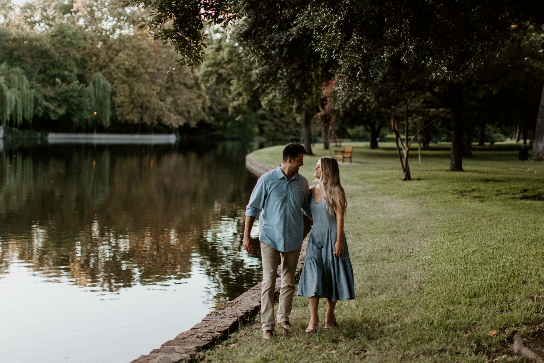 couple flirting and walking together next to a beautiful lake