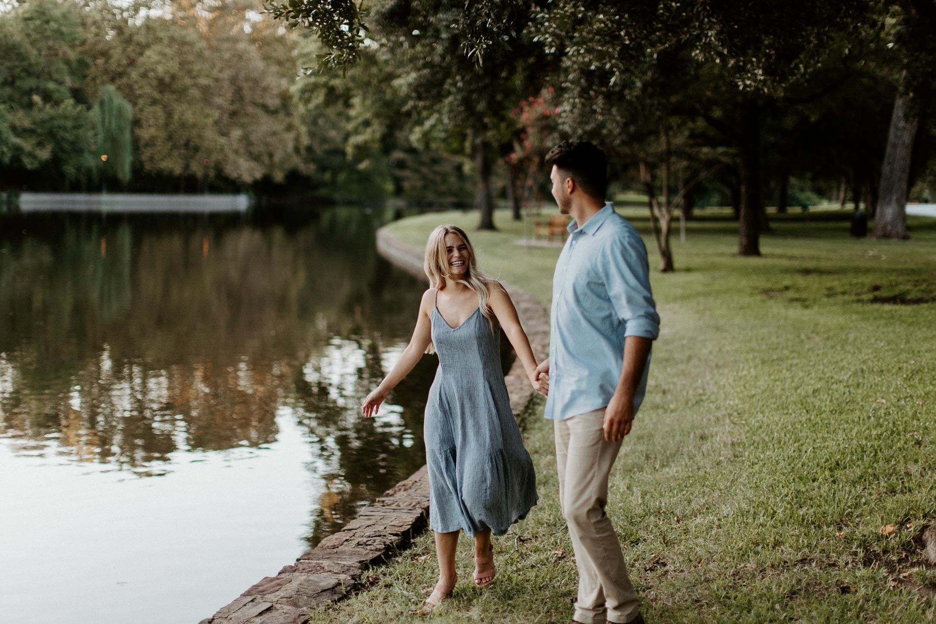 Couple being romantic and walking beside a beautiful lake location