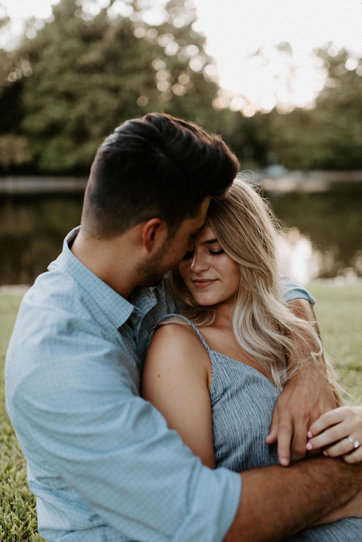 Close up photo of couple being cuddly in Dallas texas during engagement session