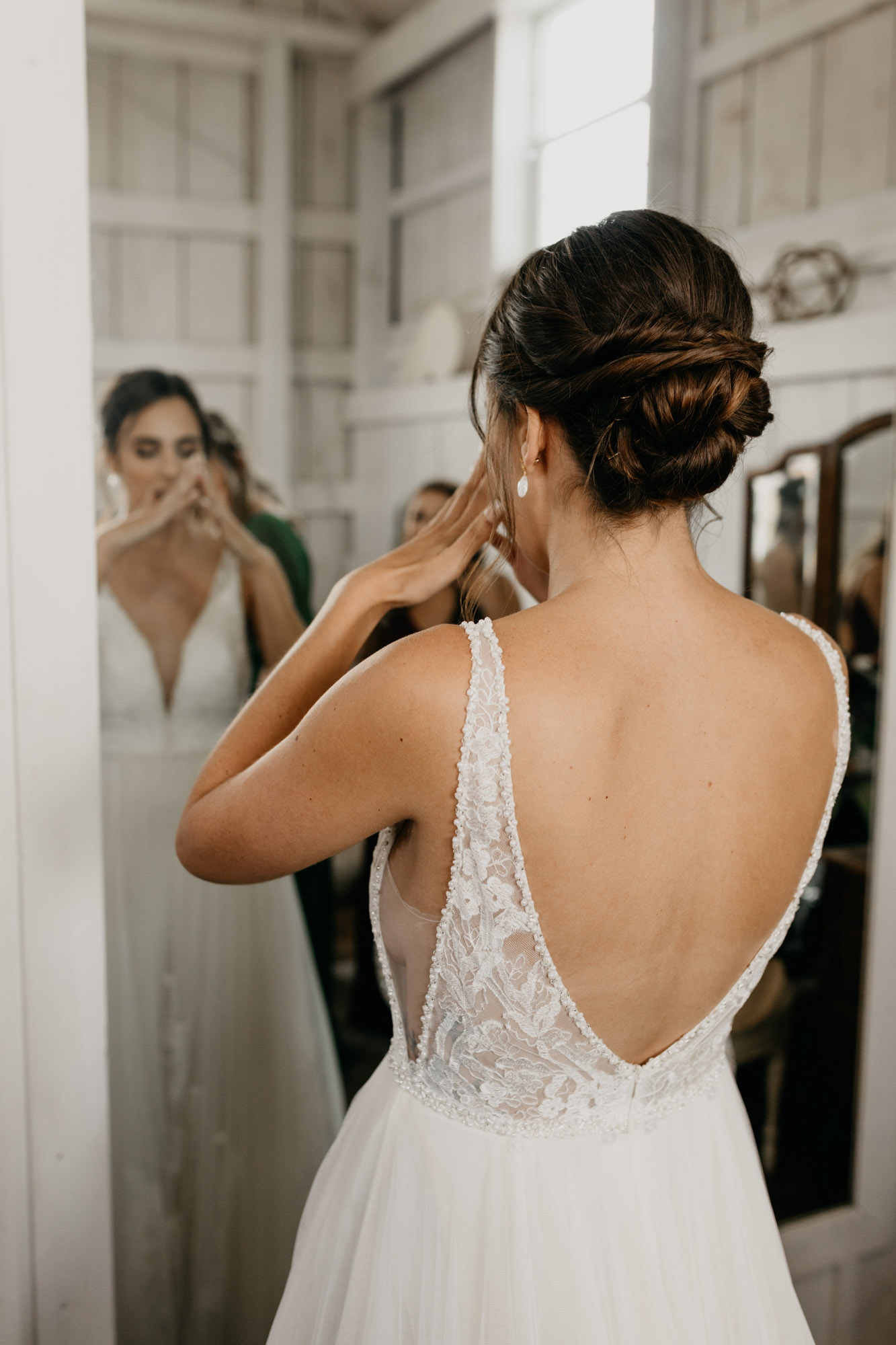Bride trying not to cry as she sees herself in her wedding dress