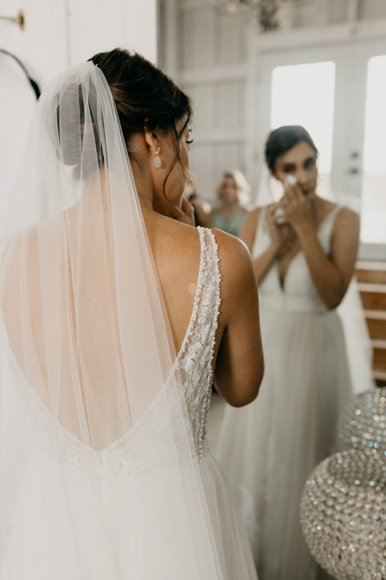 bride wiping tears from her eyes in north texas wedding