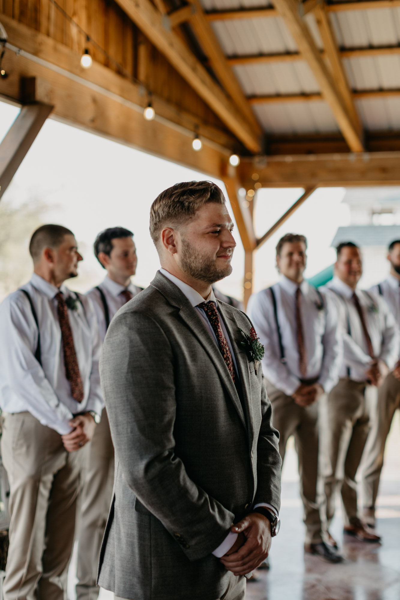 groom holding back tears as he sees his bride for the first time
