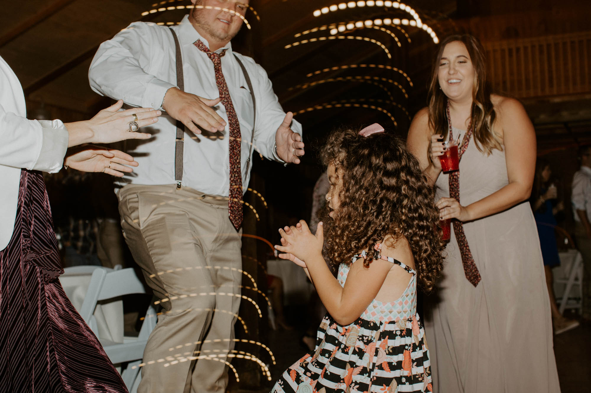 family and bridal party dancing at wedding reception in fort worth