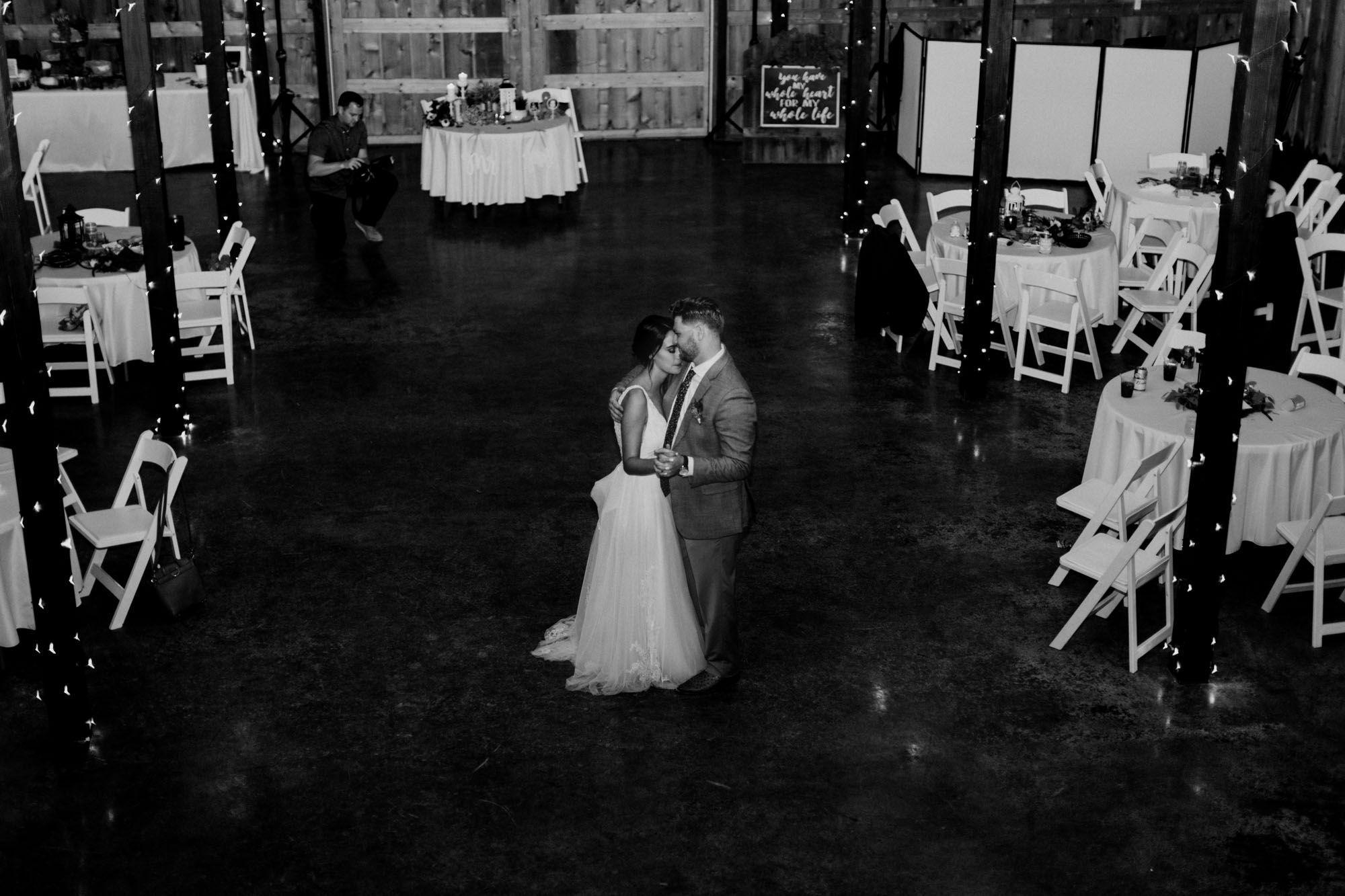 Black and white photo of bride and groom dancing on their wedding day