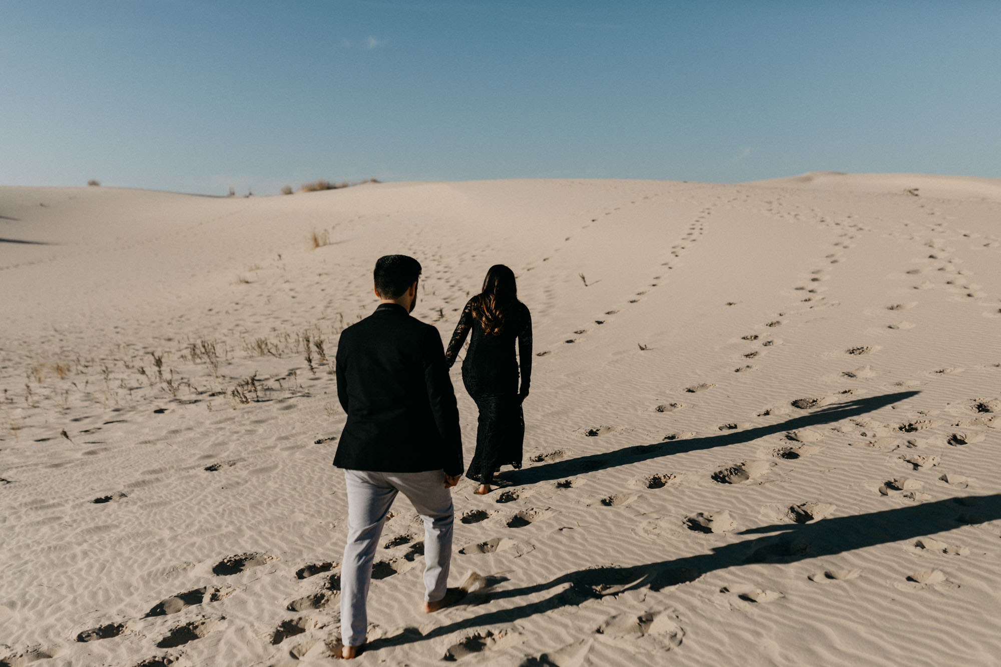Adventurous couples engagement session at sand hills