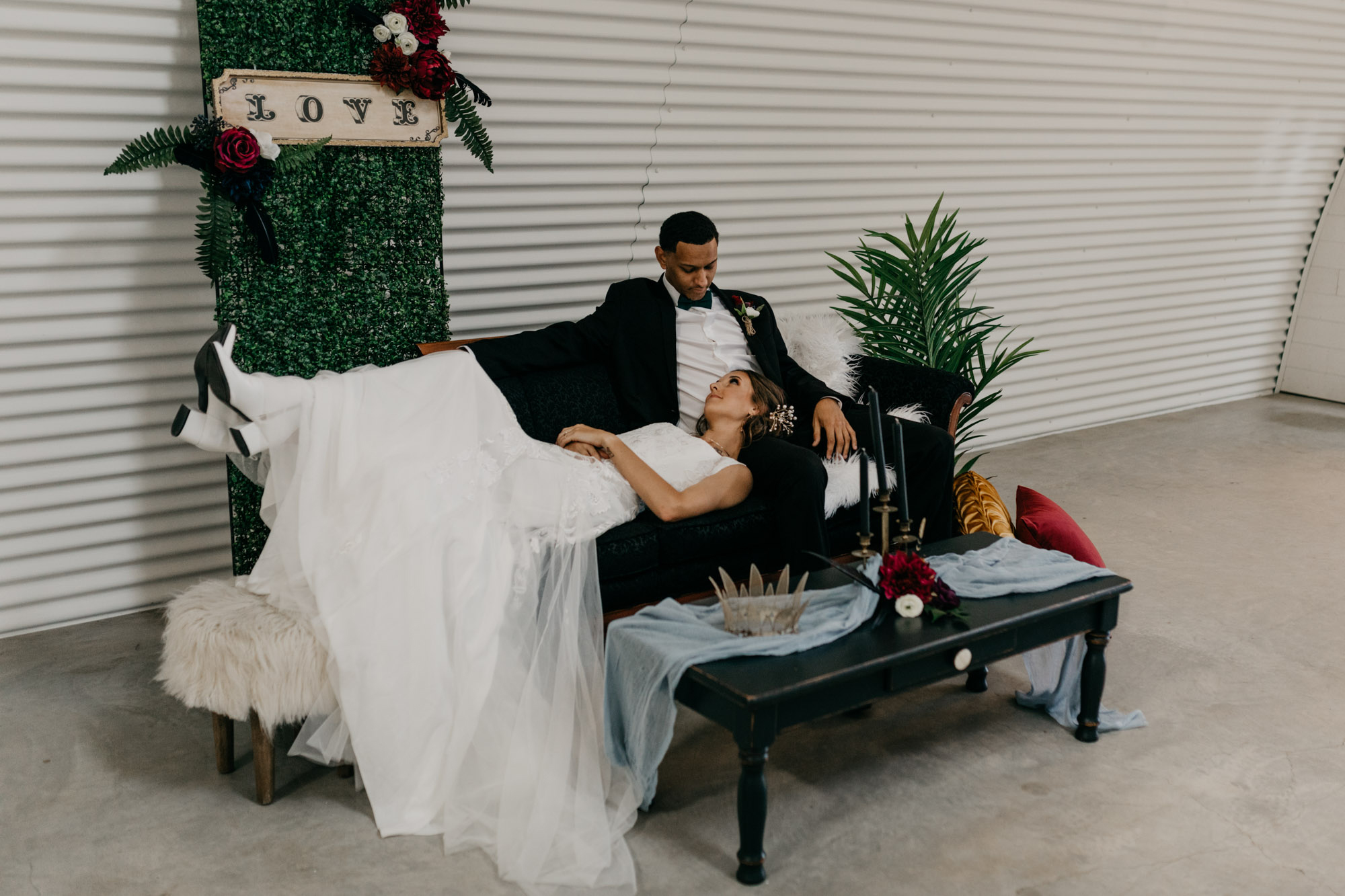 bride laying in grooms lap at styled shoot in Fort Worth