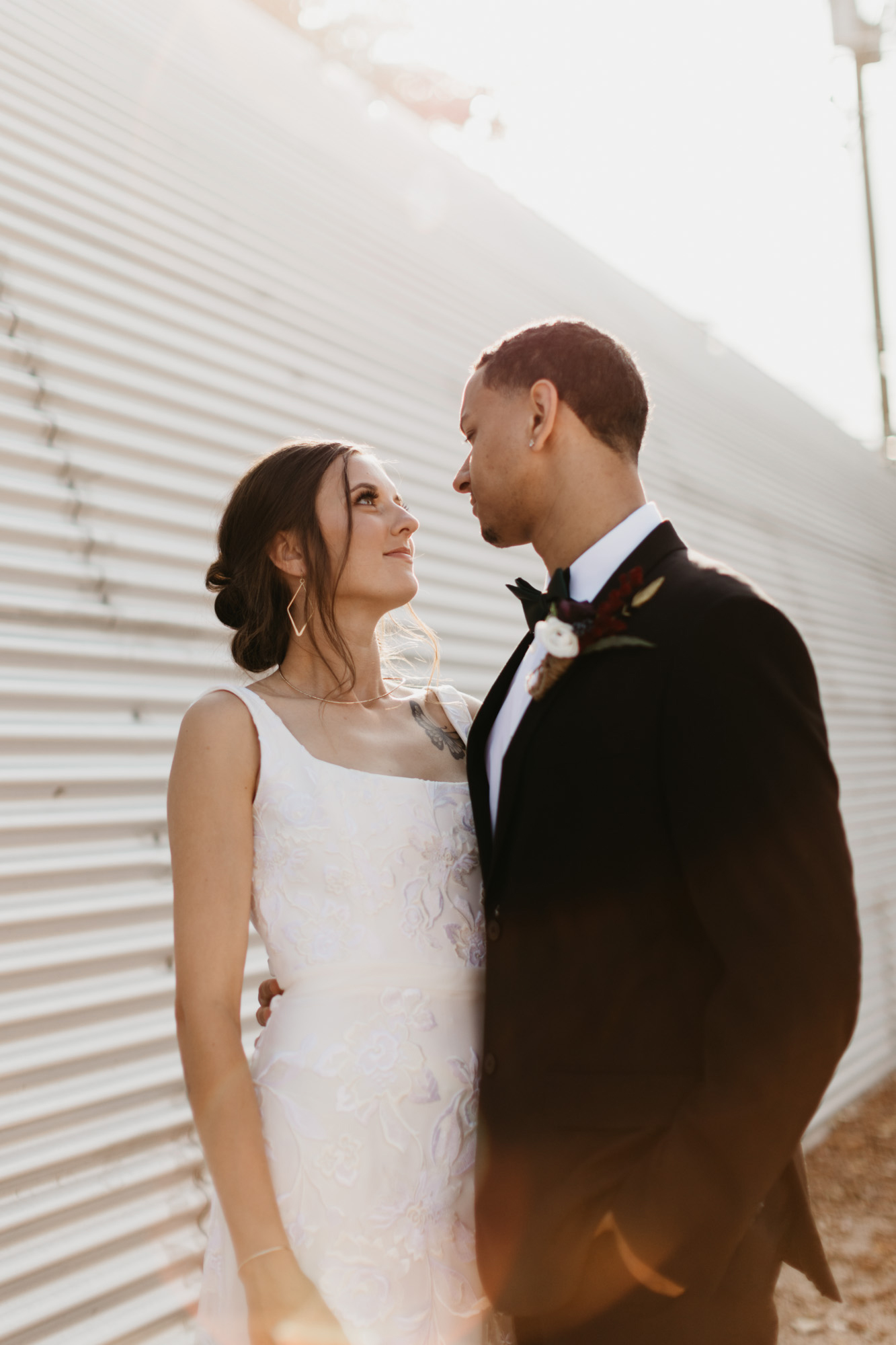 bride and groom romantically looking at each other during styled shoot