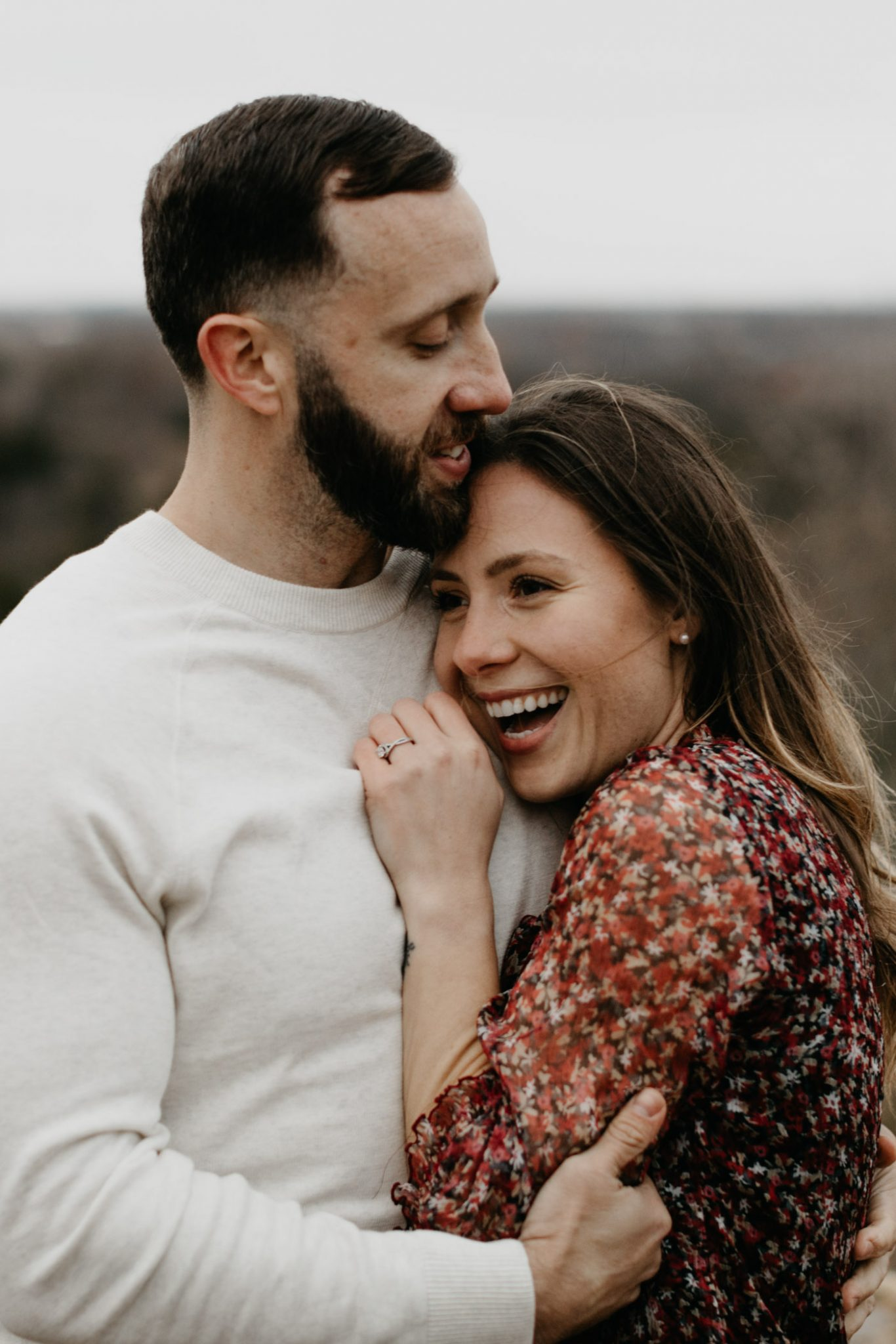 Bubbly couple taking engagement photos in fort worth