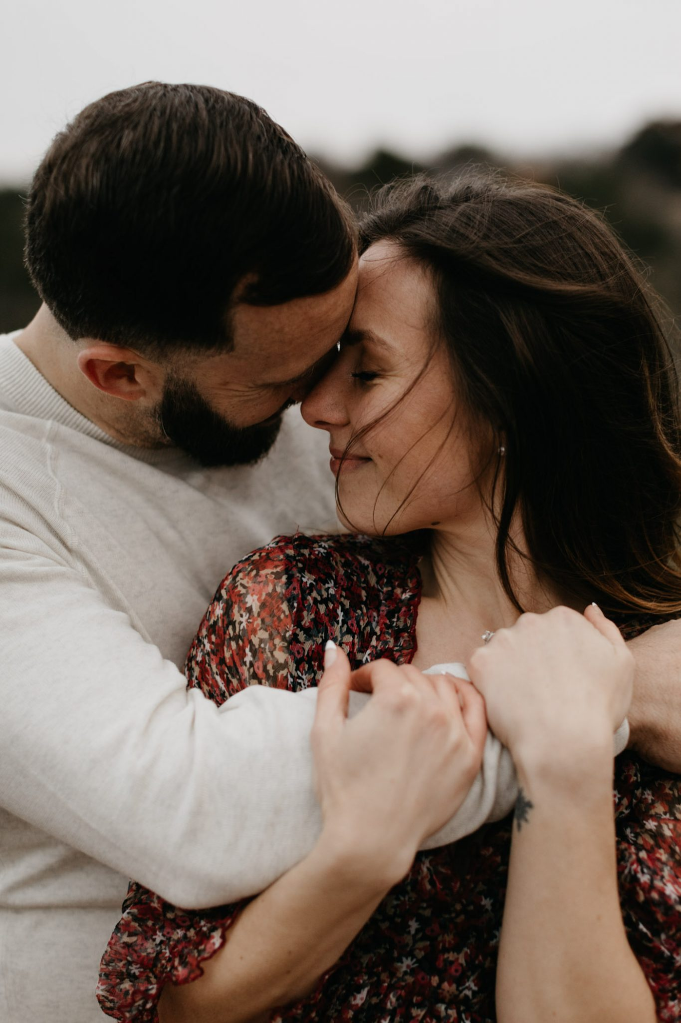 romantic couple being flirty during Fort Worth engagement session