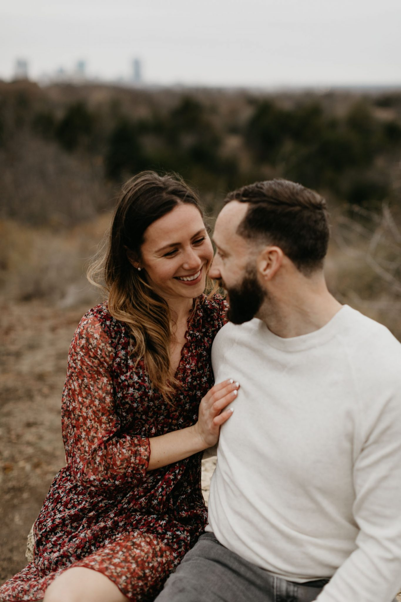 Cute couple cuddling during winter engagement session in Fort Worth