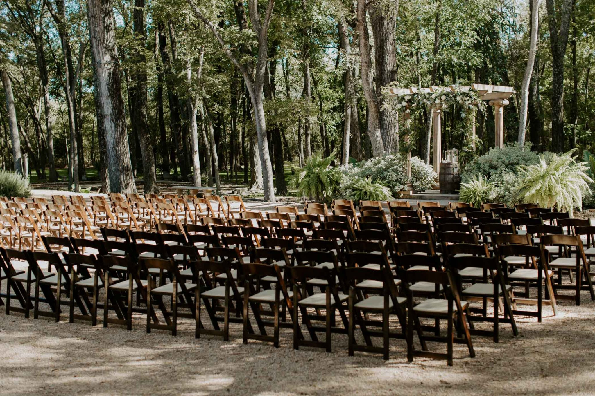 Dreamy outdoor wedding ceremony set up in the middle of a forest