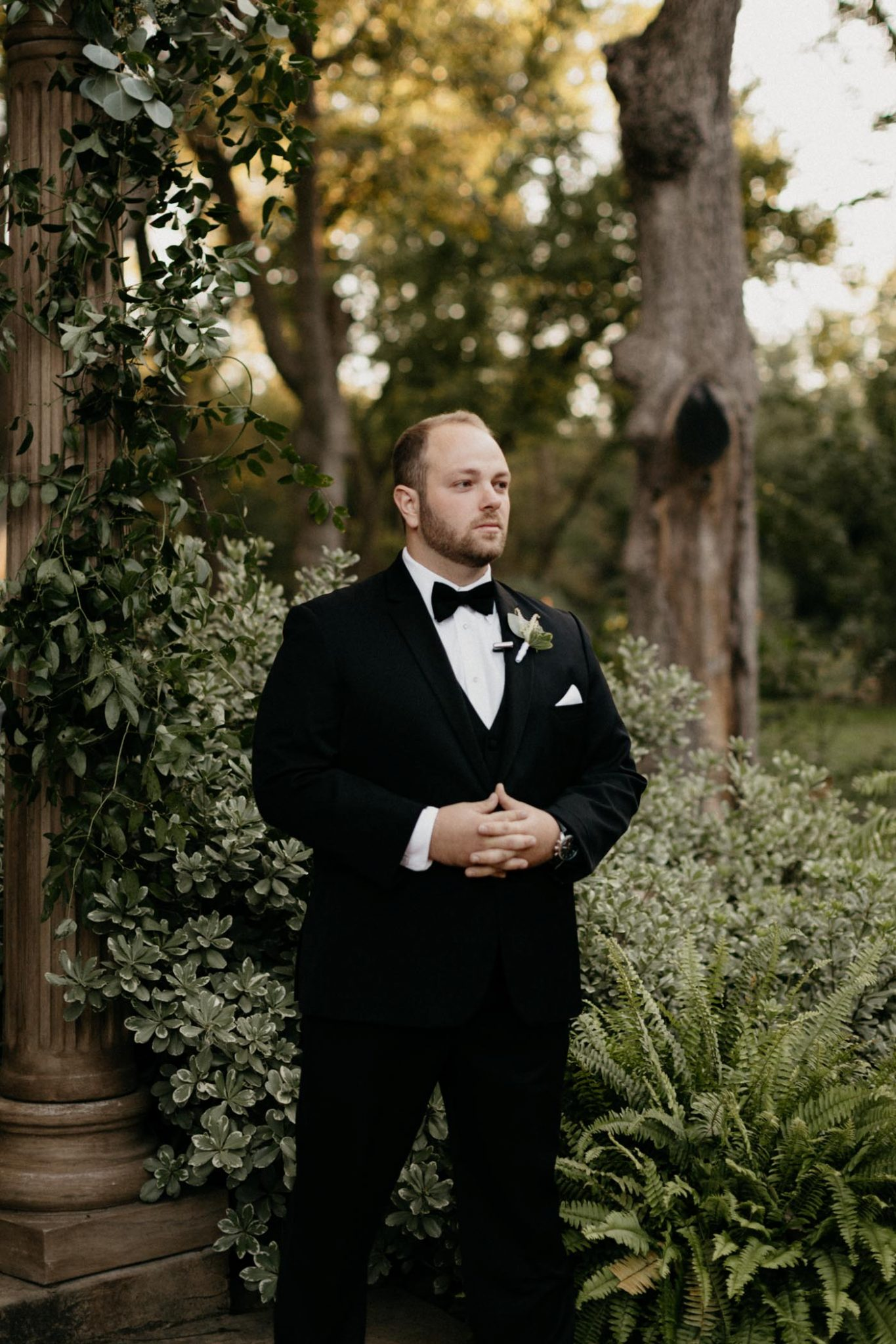 groom getting emotional as he see's his bride walking down the aisle at their elegant wedding