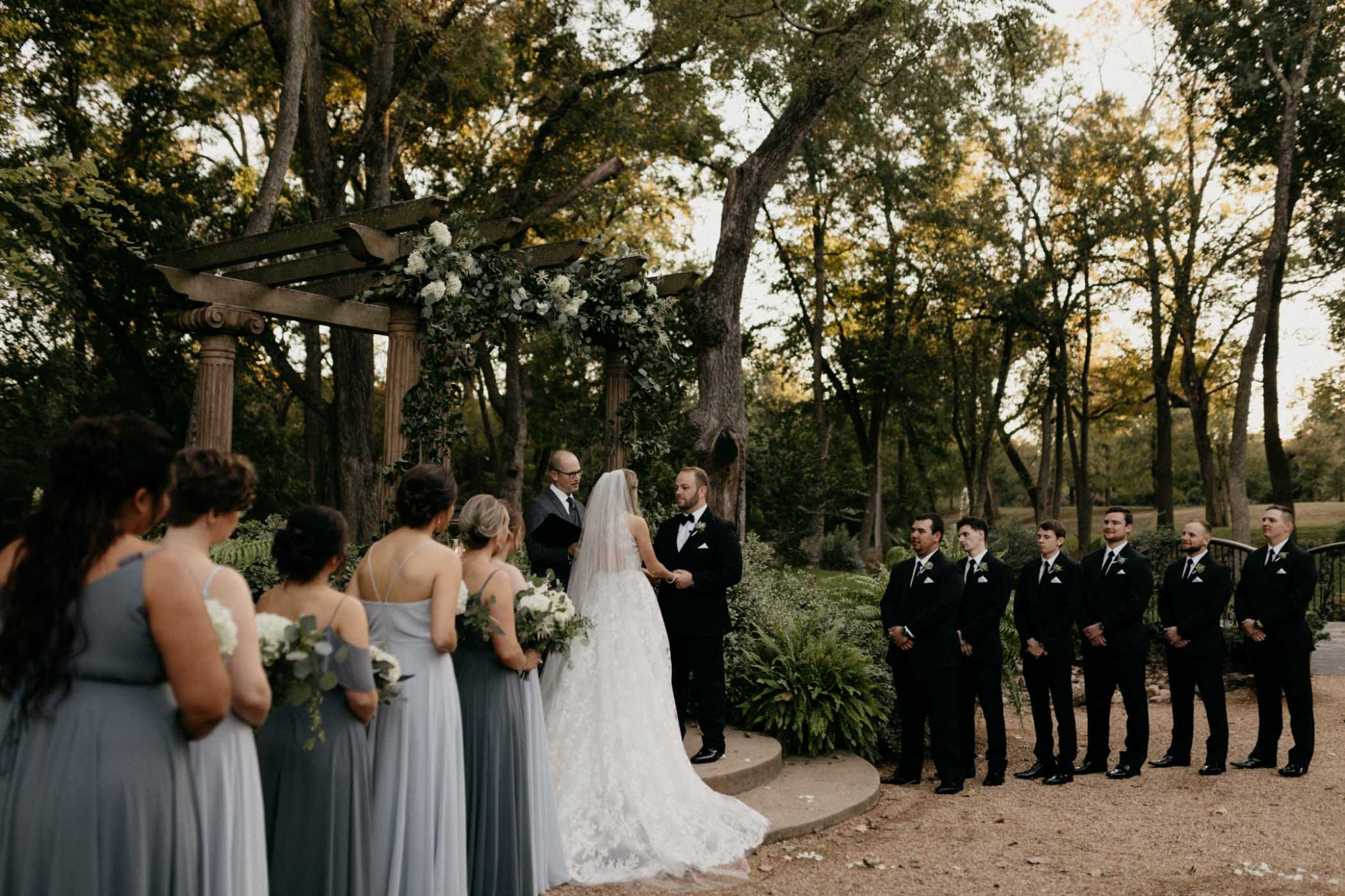 bride and groom standing at the altar with their entire bridal party