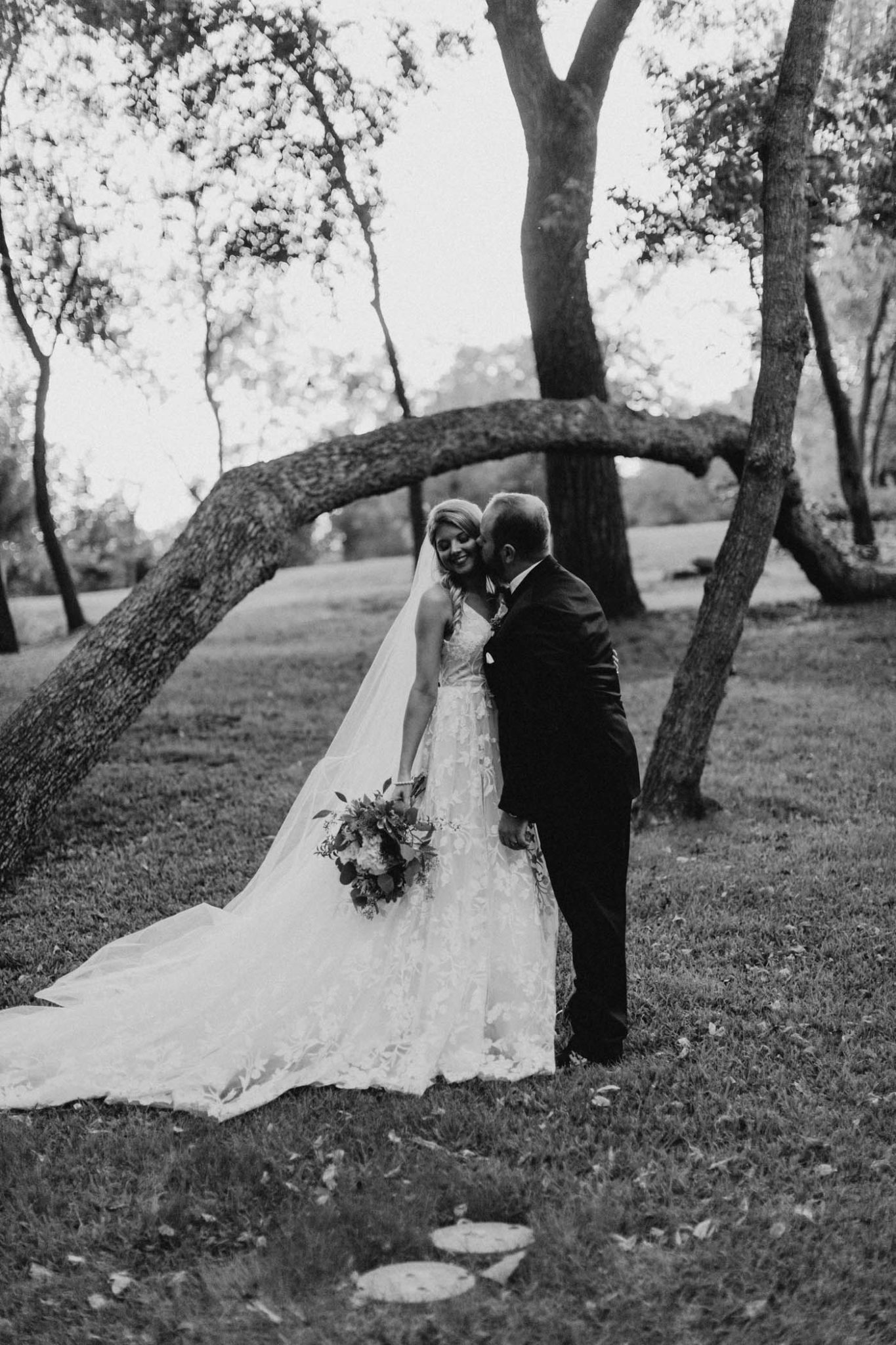 black and white intimate photo of bride and groom after wedding ceremony