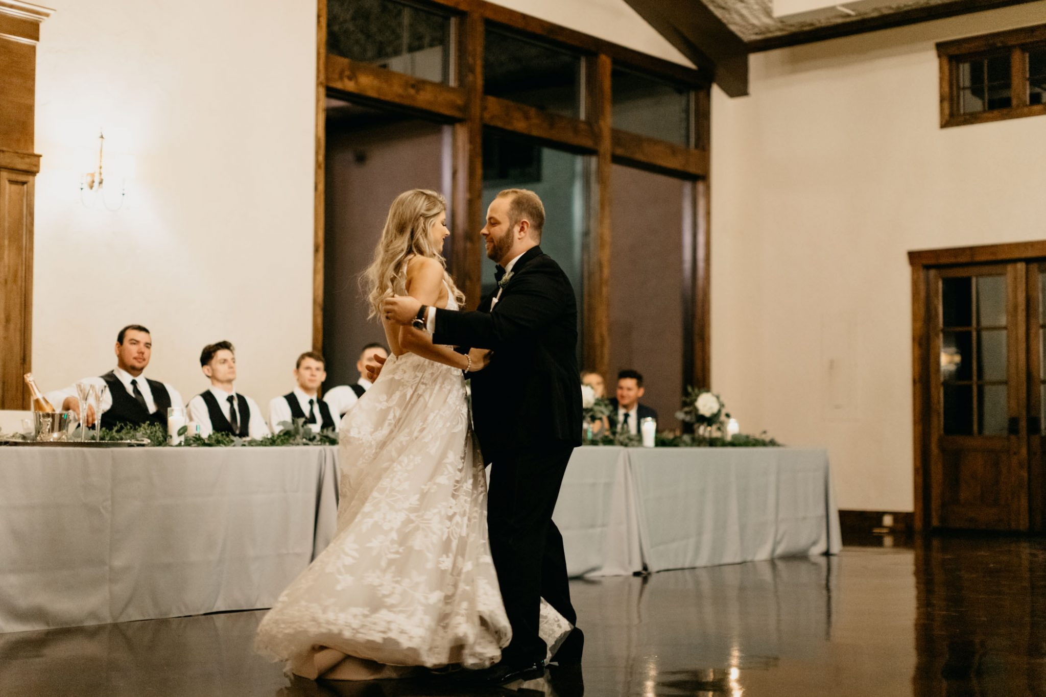 bride and groom sharing first dance at elegant wedding reception