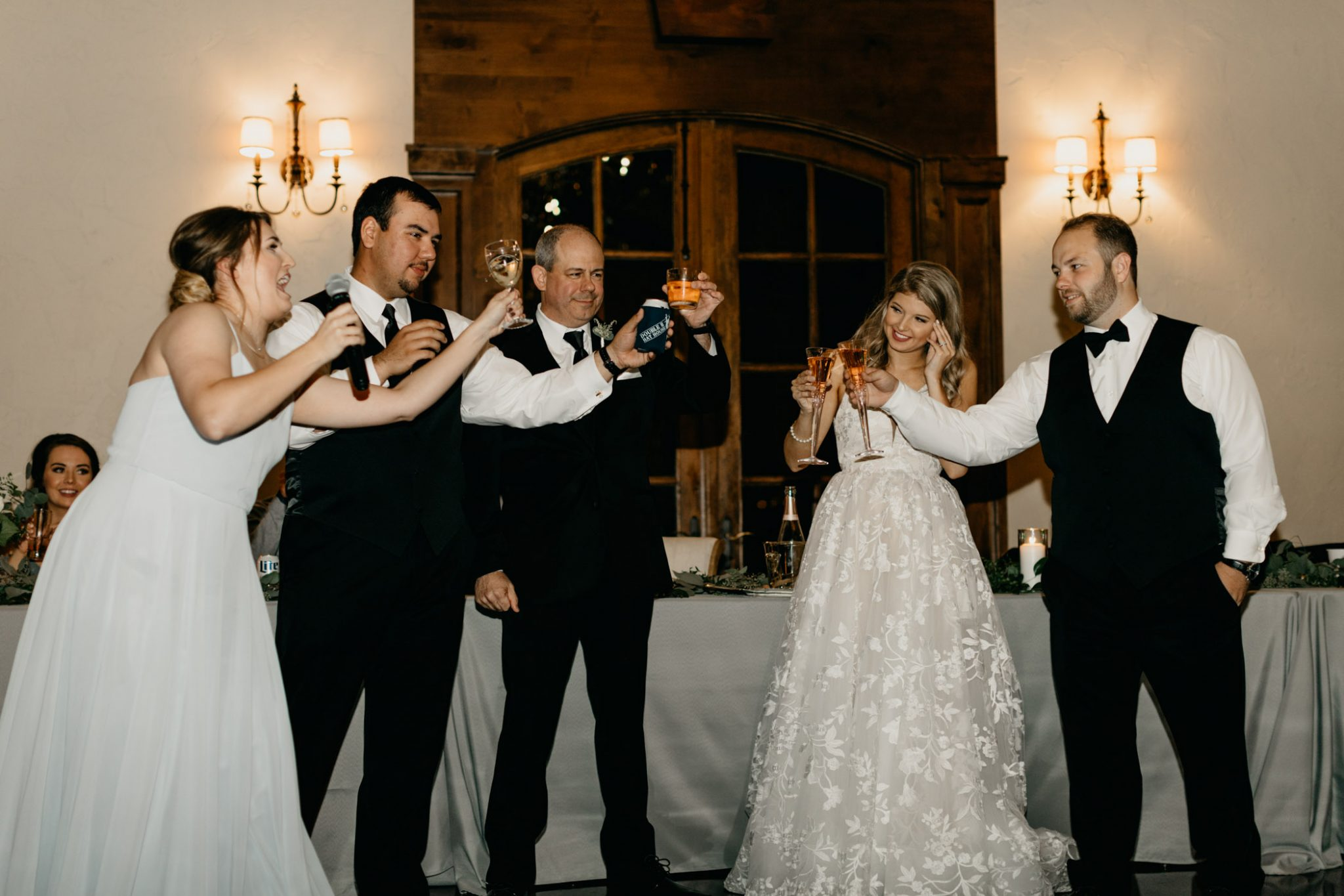bridal party toasting to the newlyweds
