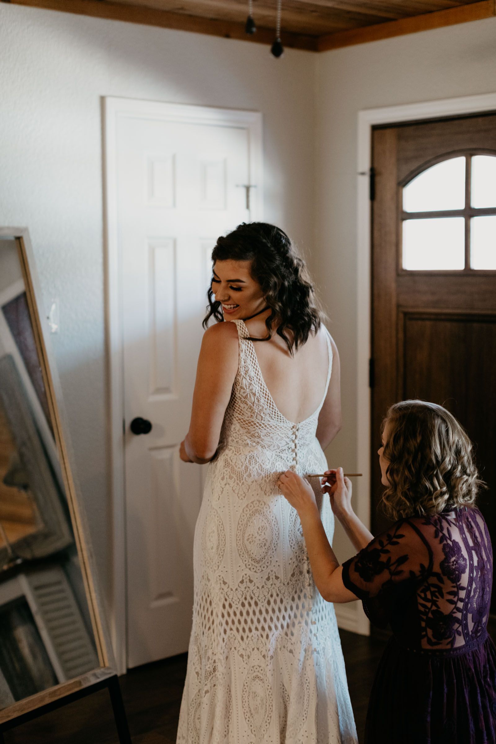 brides mom putting on her wedding dress on her wedding day in Fort Worth
