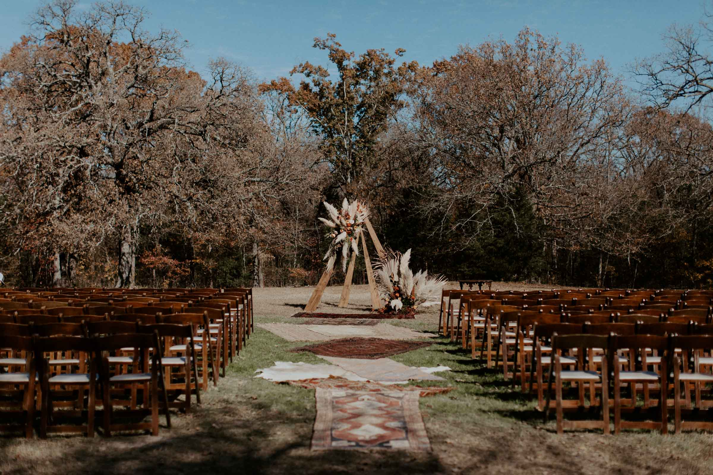 bohemian wedding day ceremony space with decor