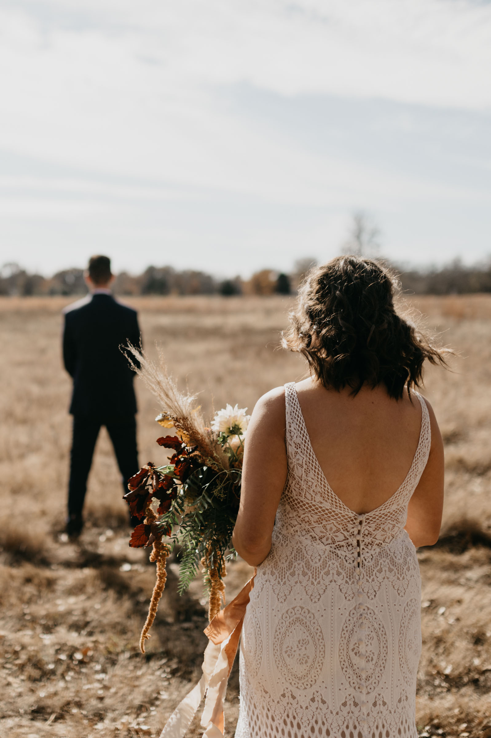 Bride and groom sharing their first look in an open field in east texas