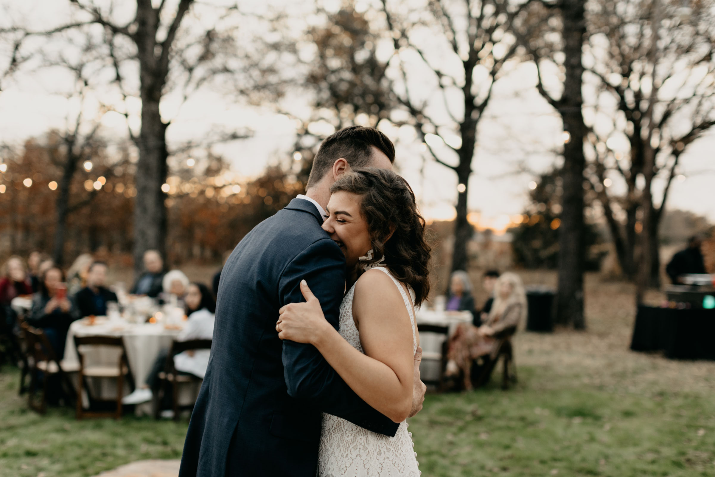 Bride smiling as she shares her first dance with her husband