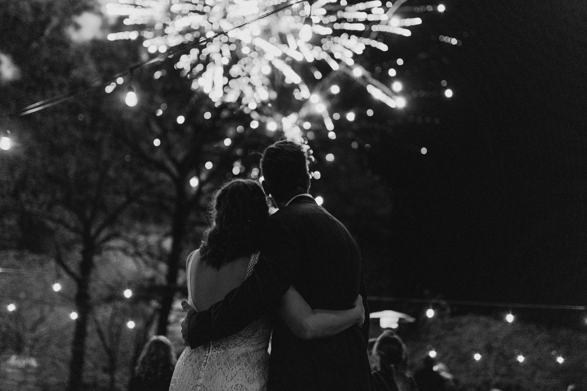 black and white of fireworks show in Fort Worth Texas during outdoor wedding day