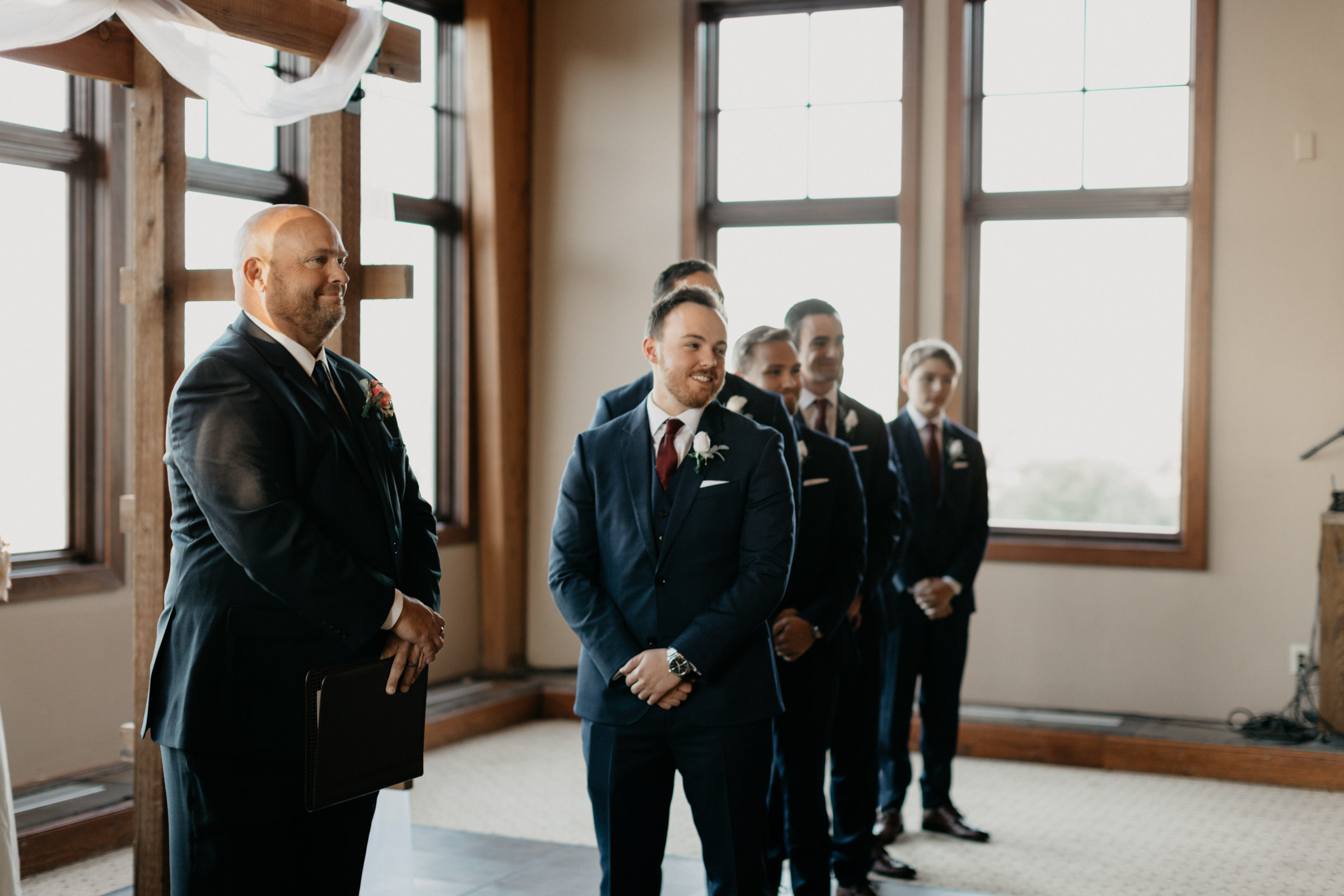 Groom waiting for his bride at the altar of a country club