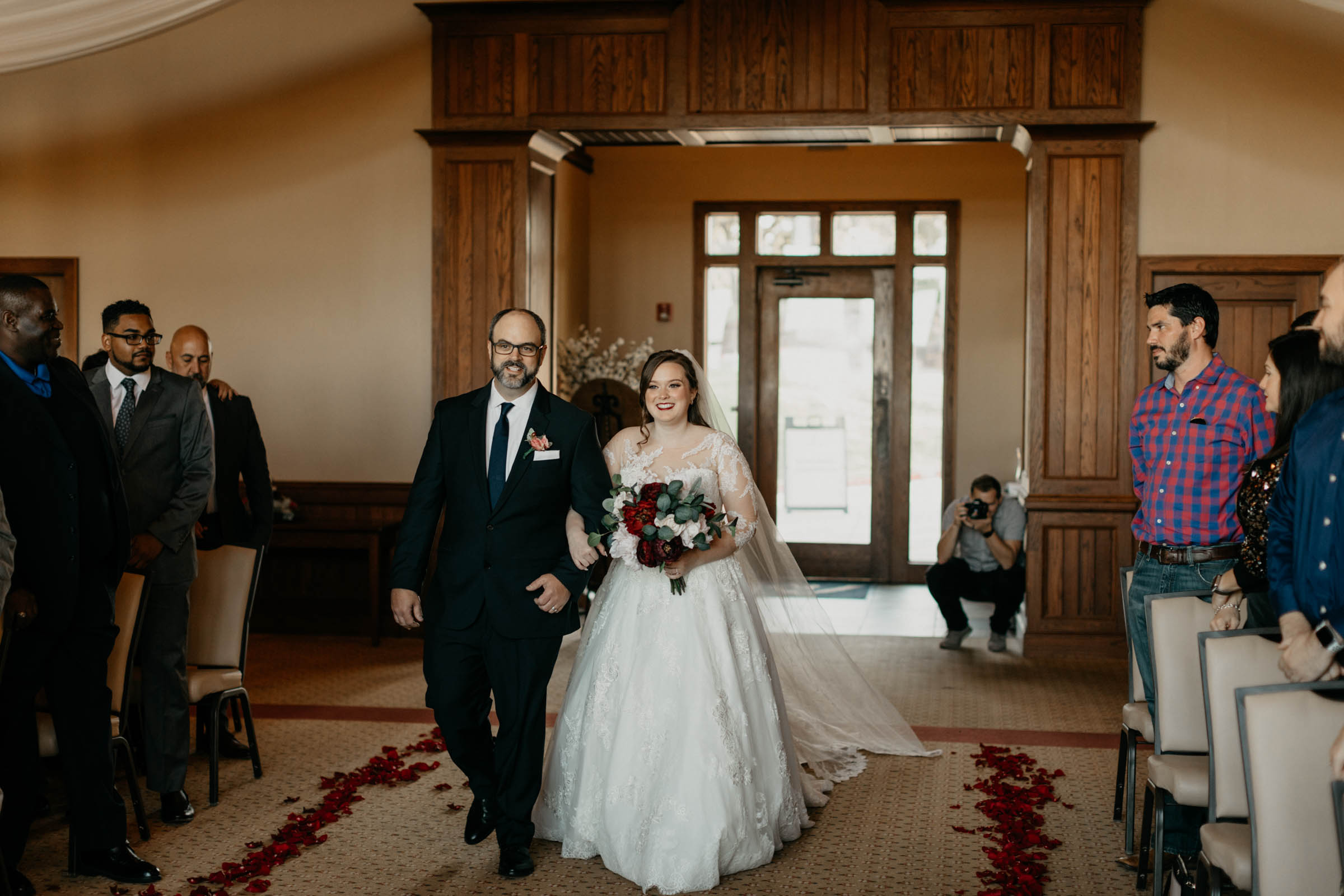 stunning bride walking down the aisle in a princess dress