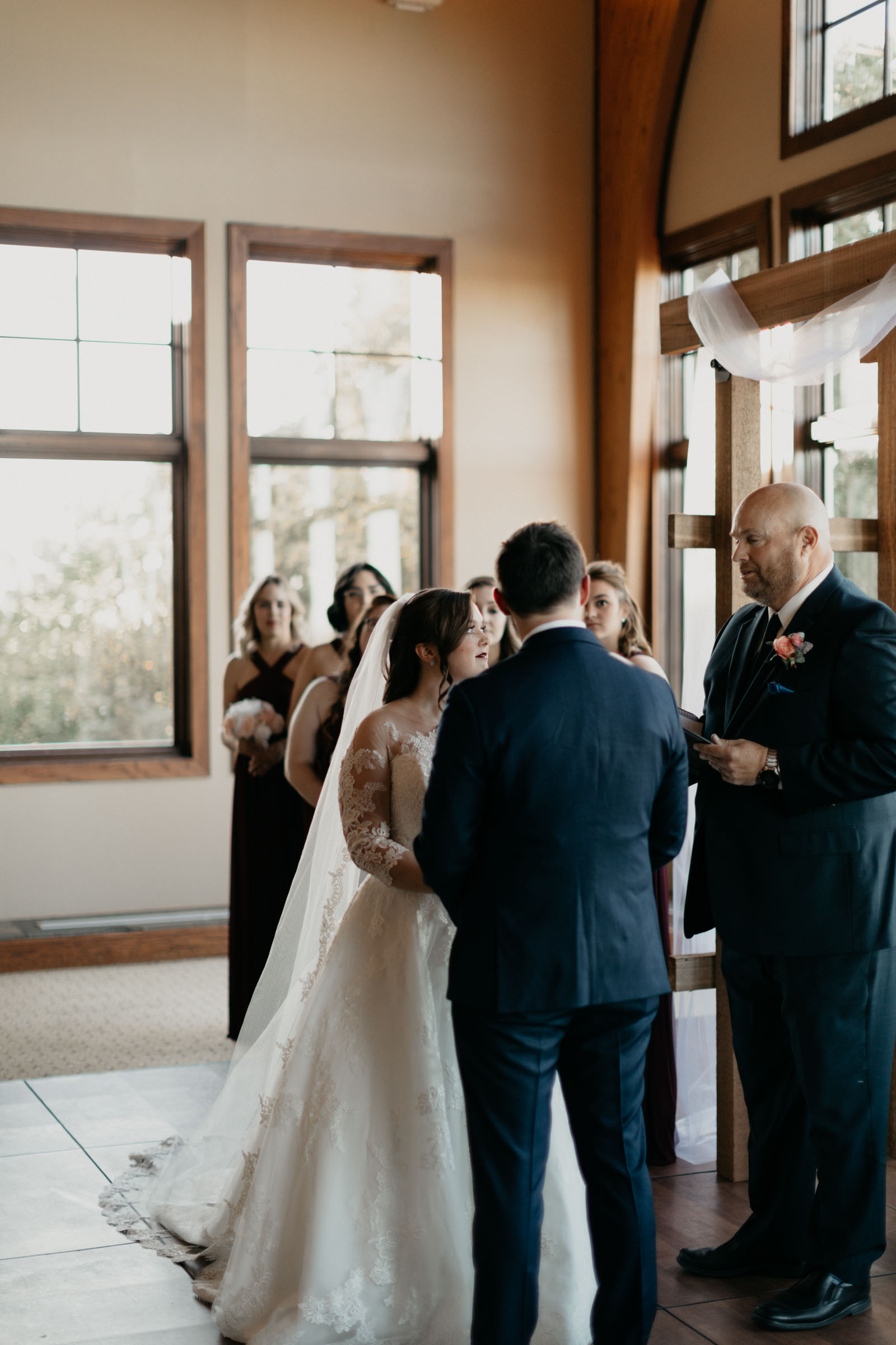 bride and groom exchanging vows during their traditional wedding day