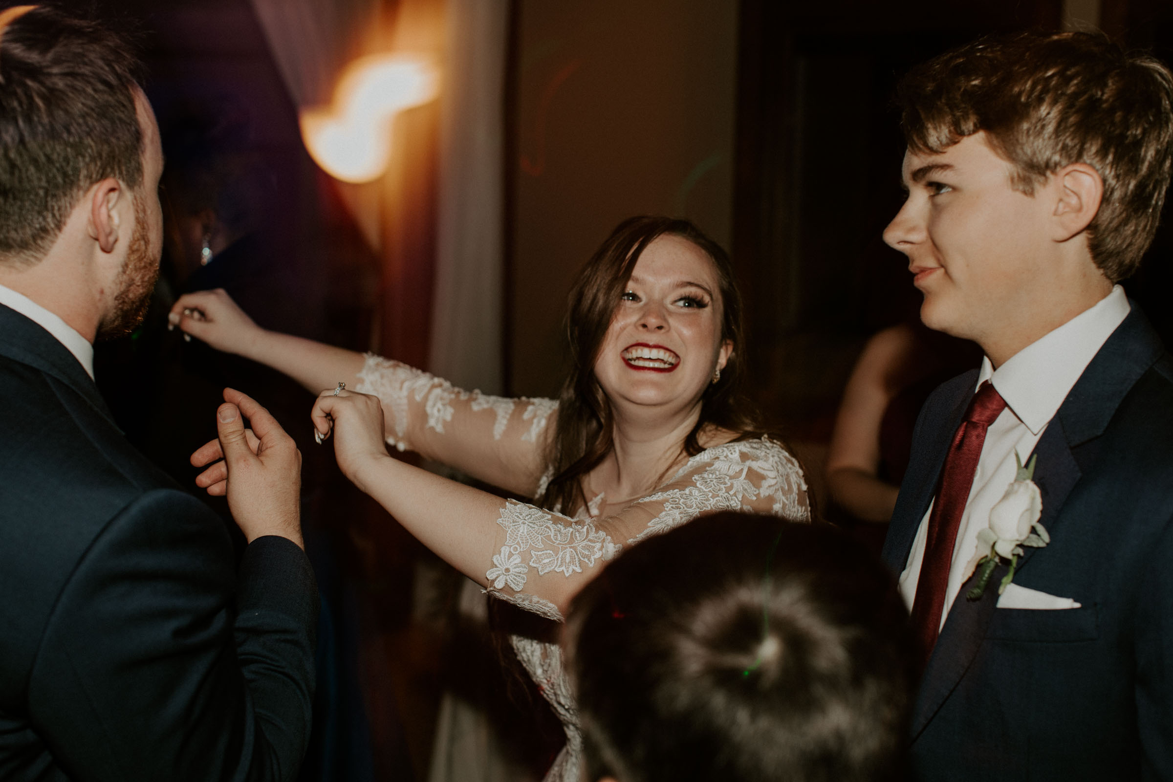 bride smiling and dancing at wedding reception