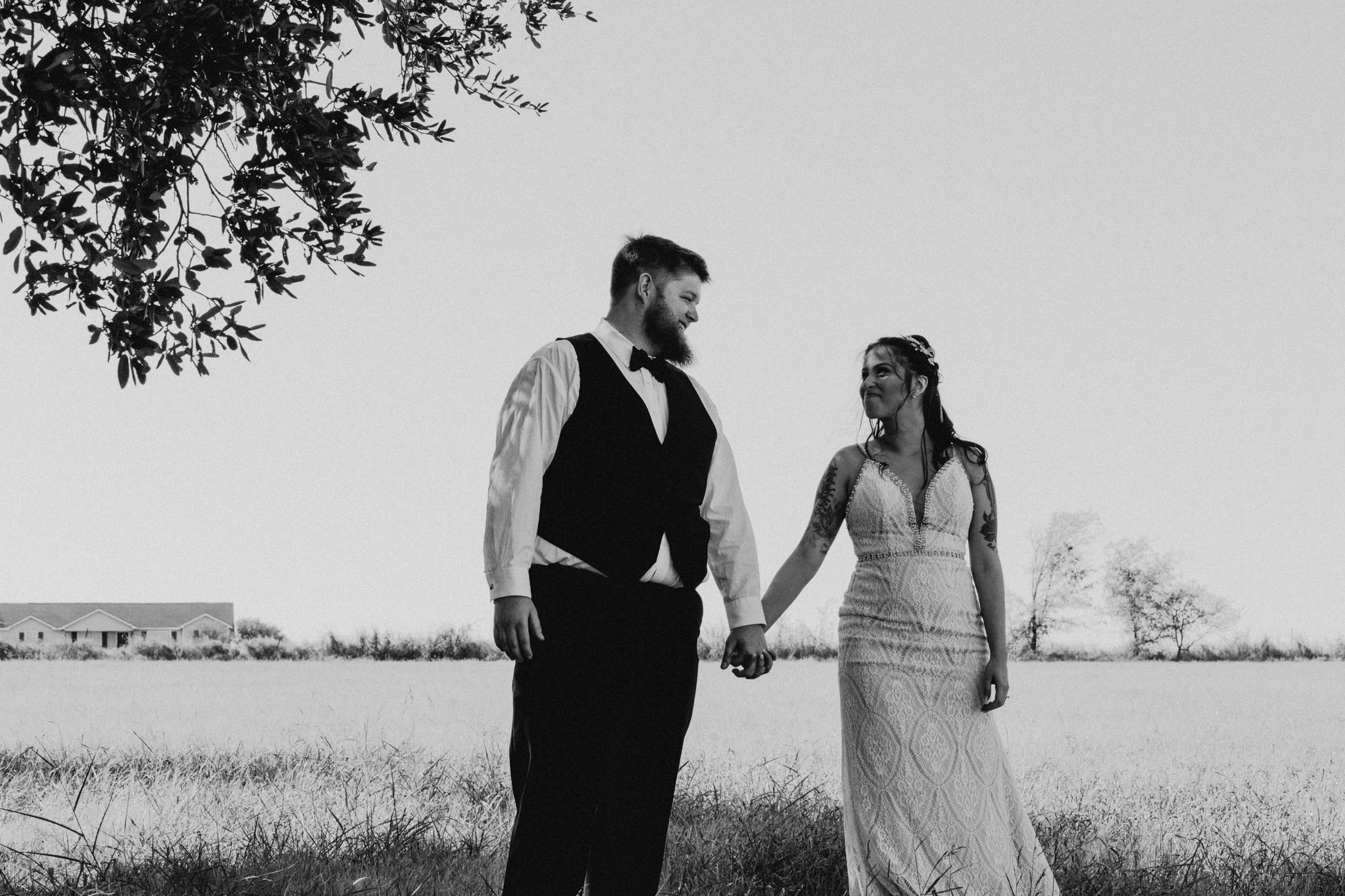 black and white of newlywed bride and groom portraits in a field in North Texas
