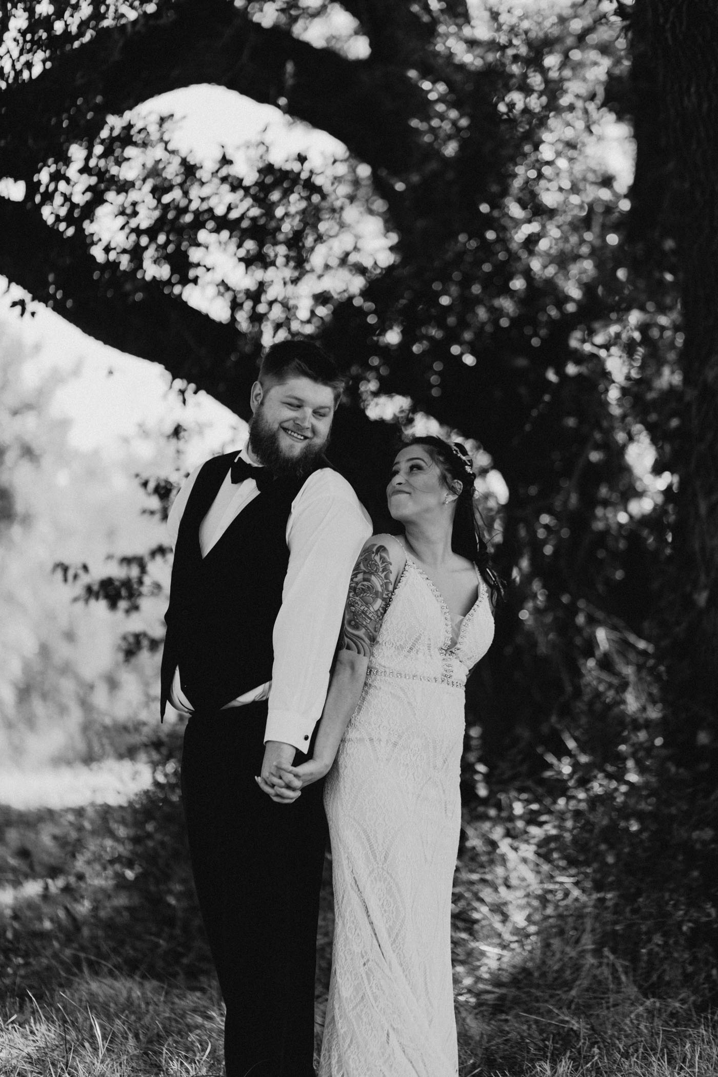 black and white of bride and groom standing back to back after wedding ceremony