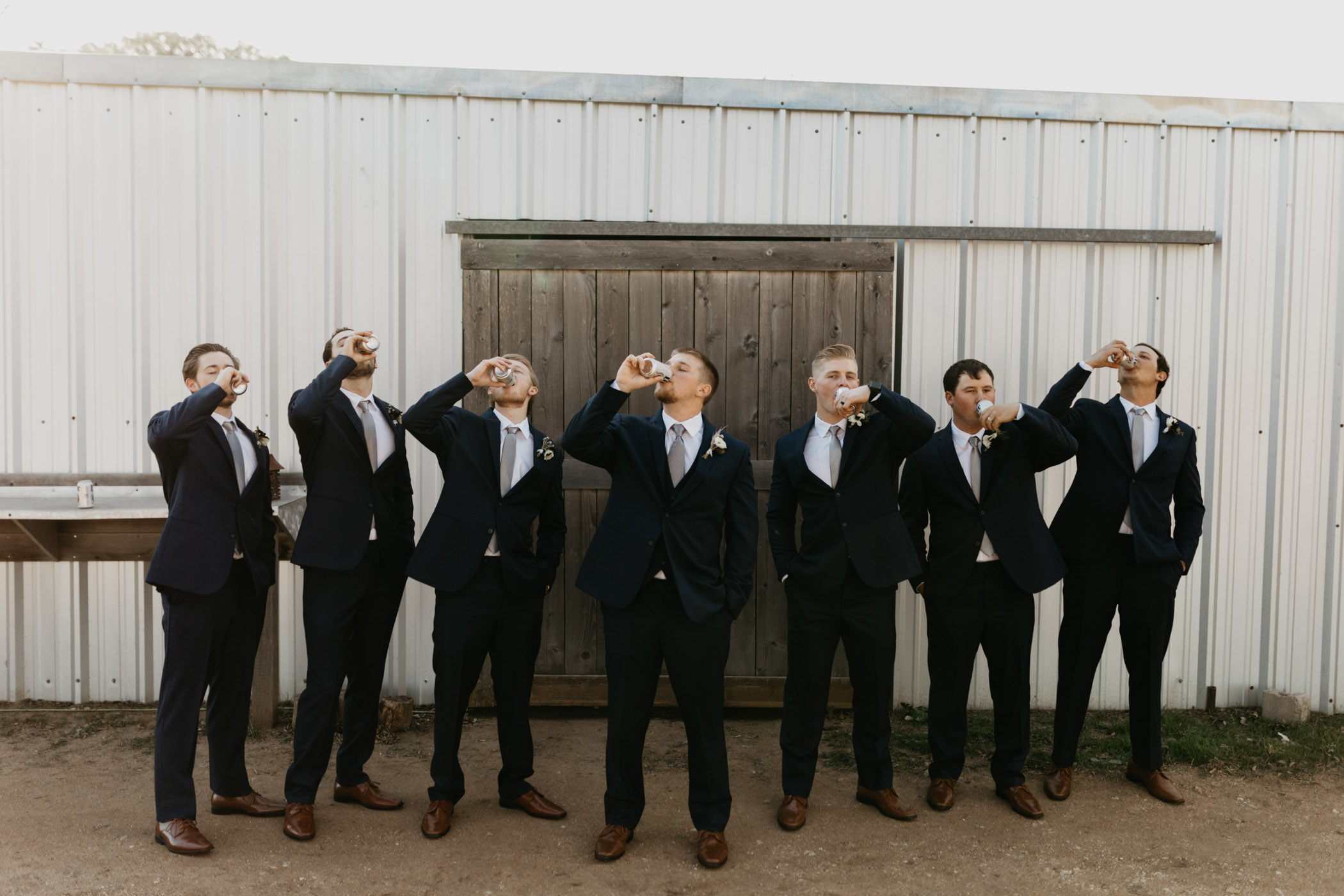 groomsmen drinking beer and celebrating before wedding ceremony starts