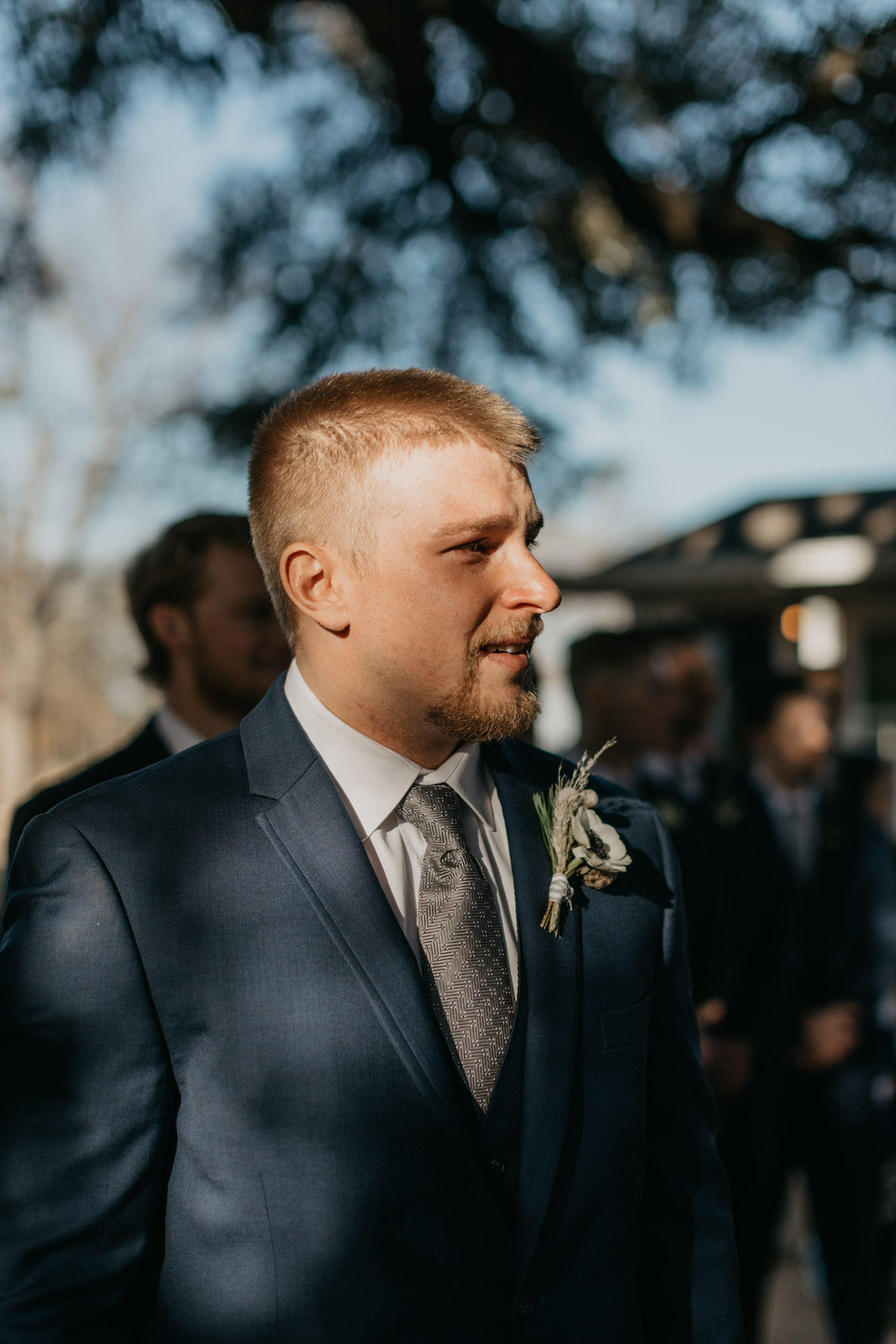 groom crying as he sees his bride walk down the aisle