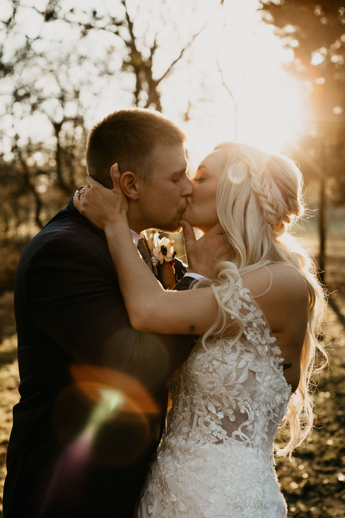 golden hour light leak photo of bride and groom after winter wedding ceremony