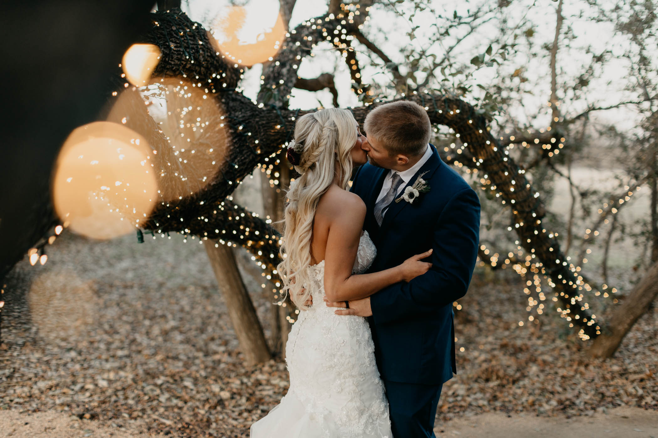 sparkle Christmas lights on tree during bride and groom wedding day