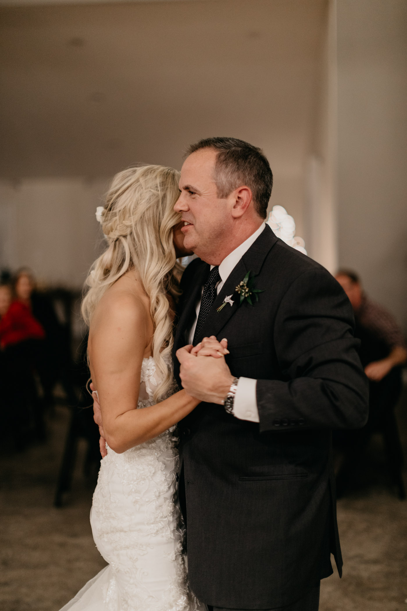 brides dad dancing with her during wedding reception