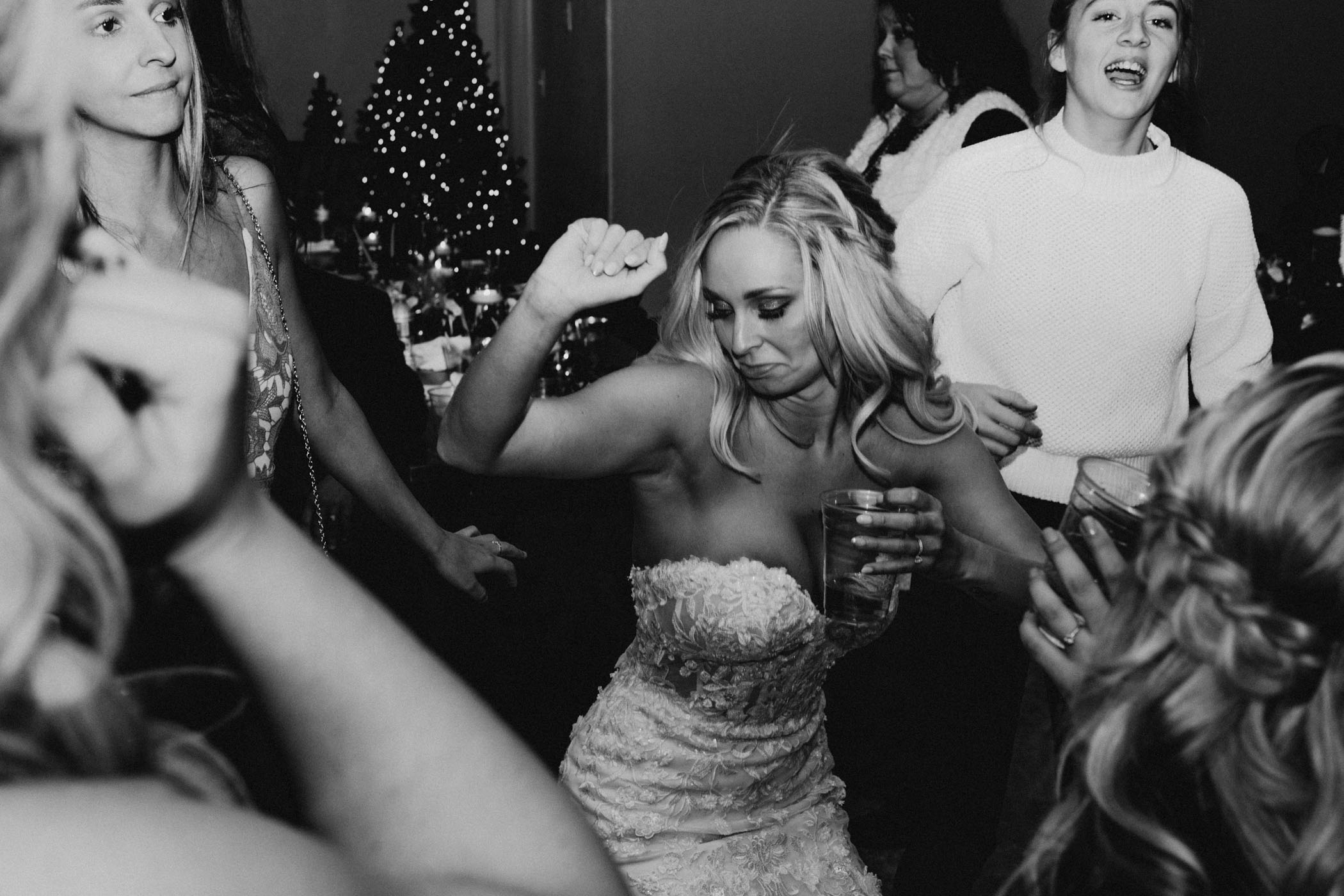 black and white of bride dancing on wedding day