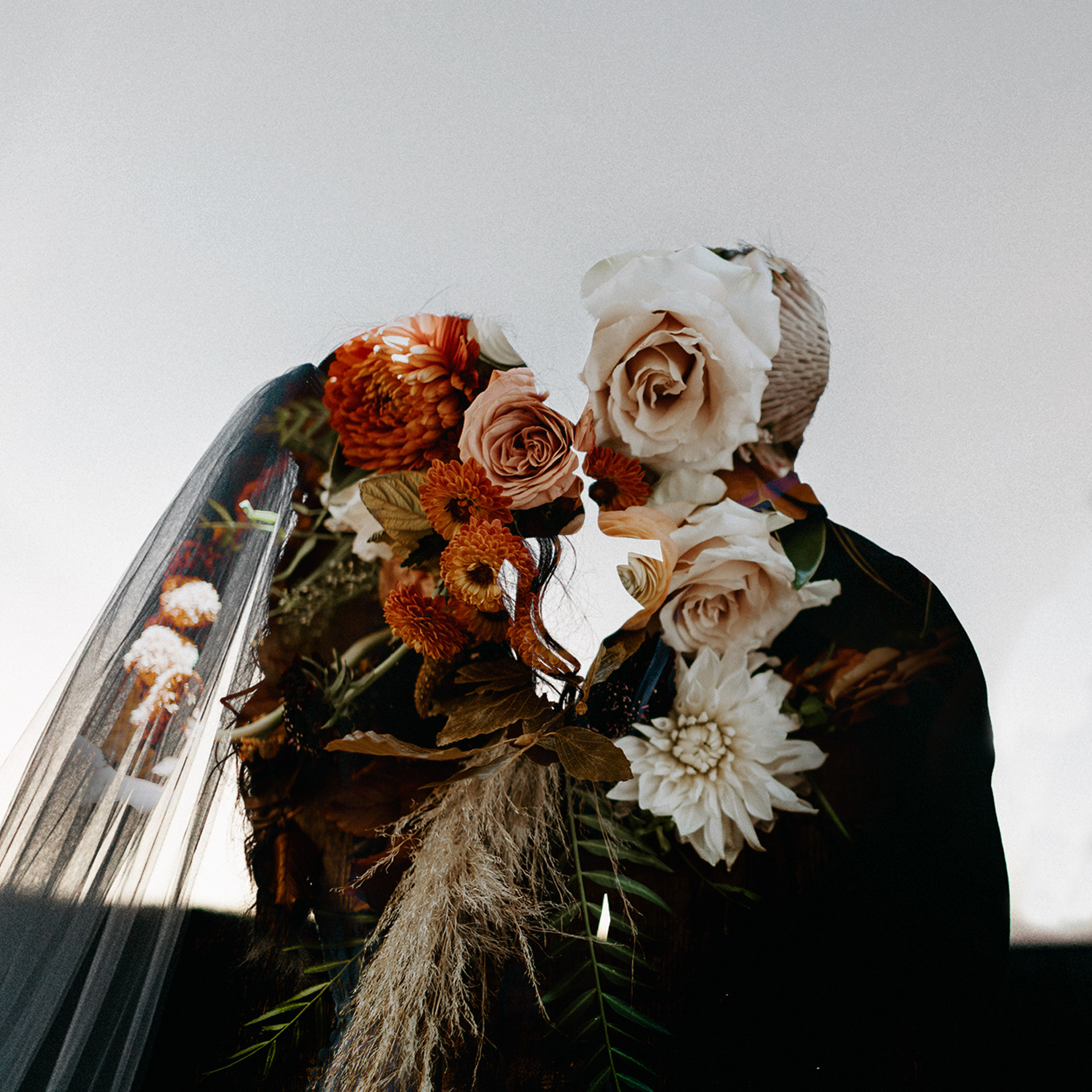 Double exposure on wedding day with wedding flowers and couples silhouette