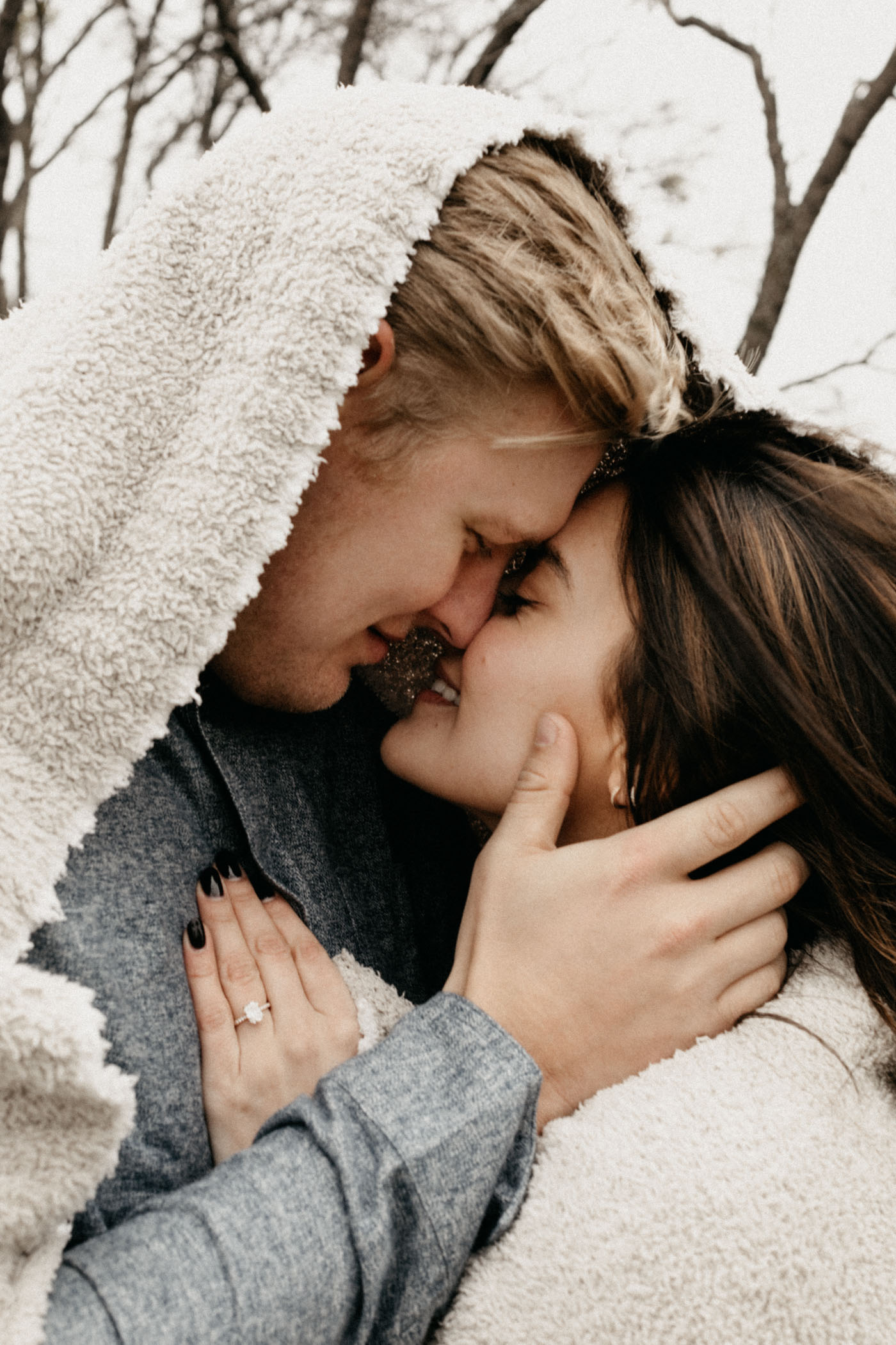 snuggly couple about to kiss during Fort Worth engagement session