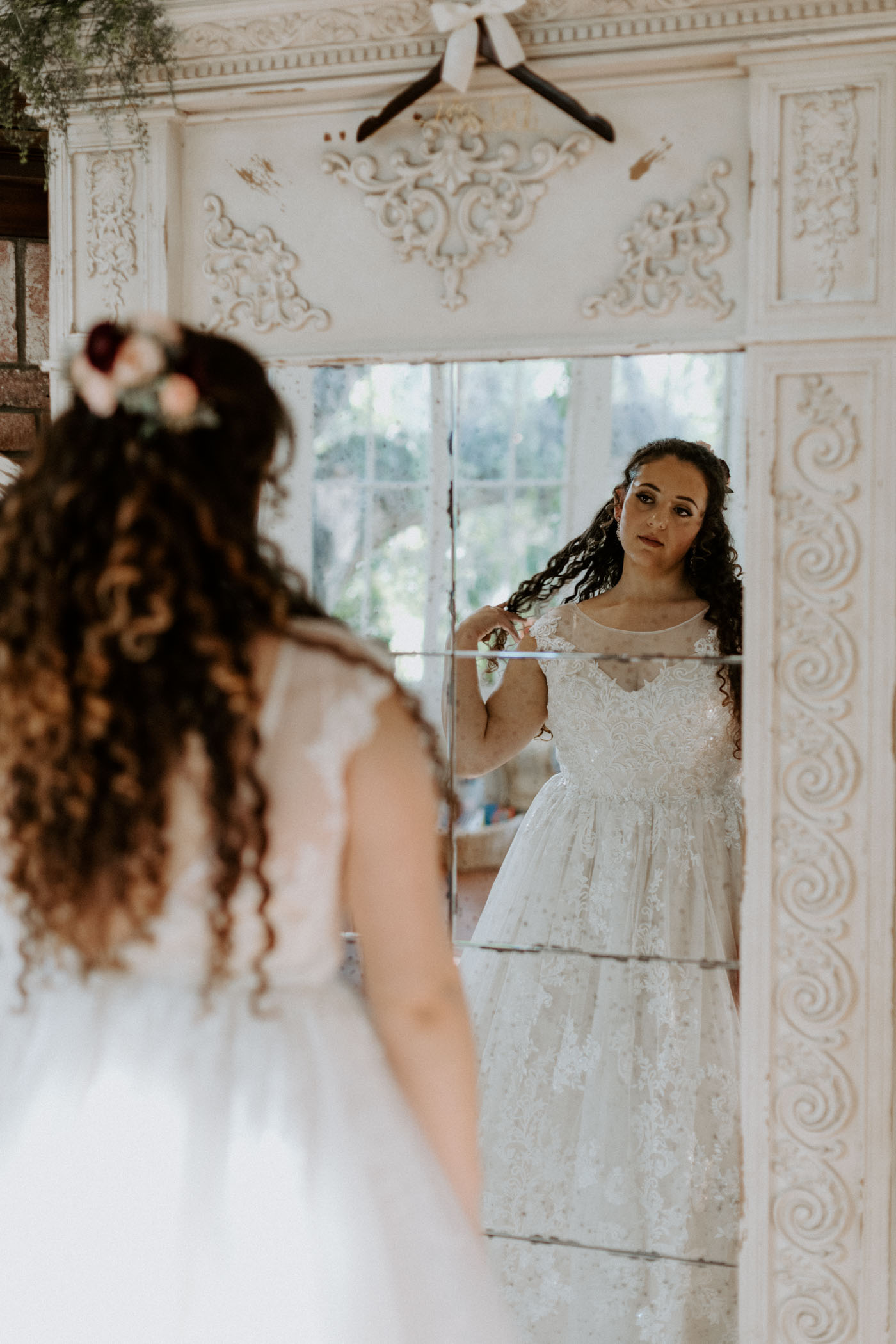 Bride looking in the mirror before her wedding begins
