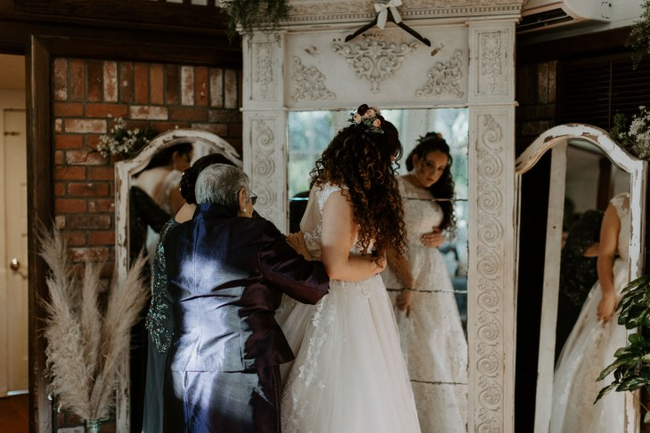 Brides family getting dressed before wedding ceremony in California
