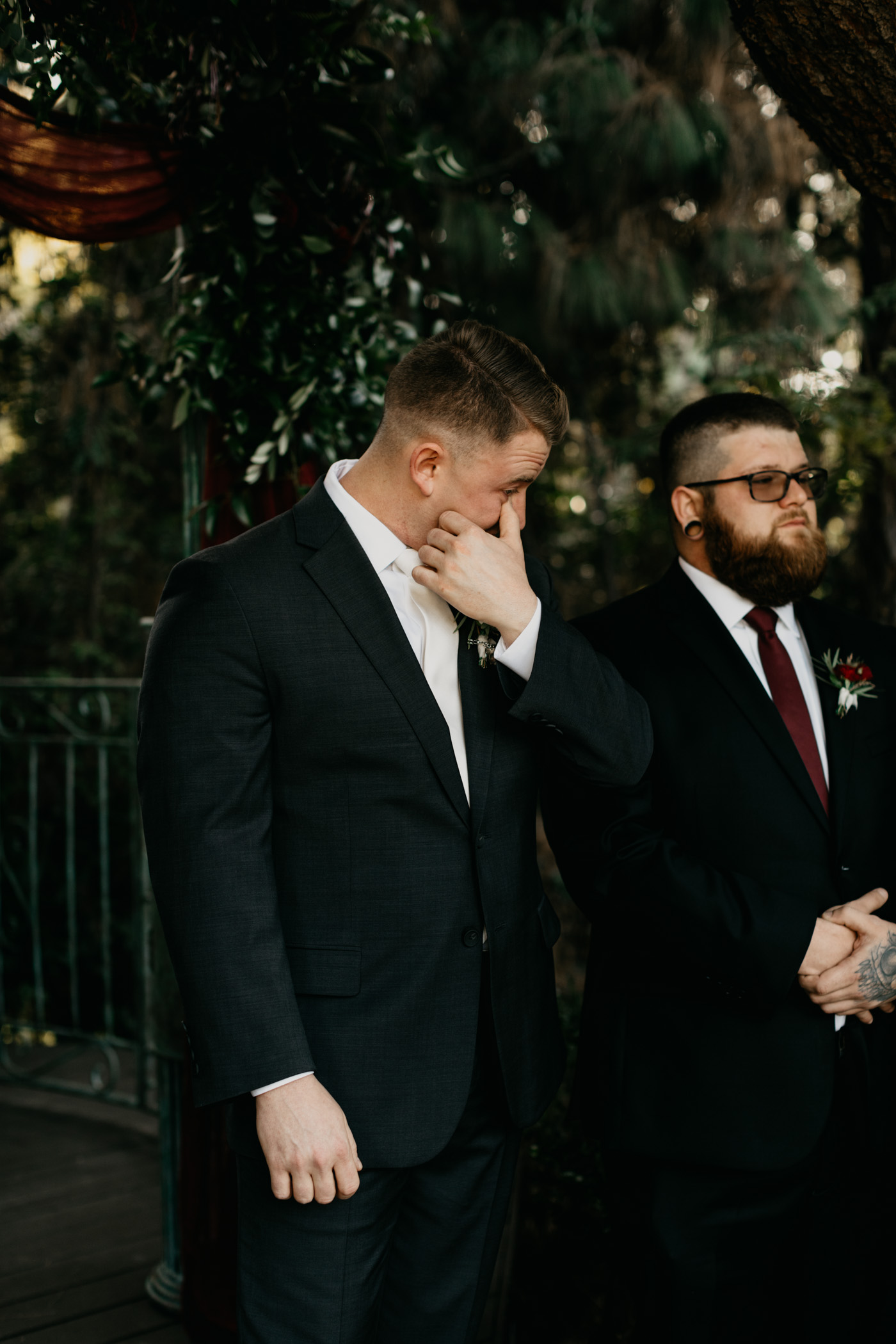 Groom crying as his bride walks down the aisle