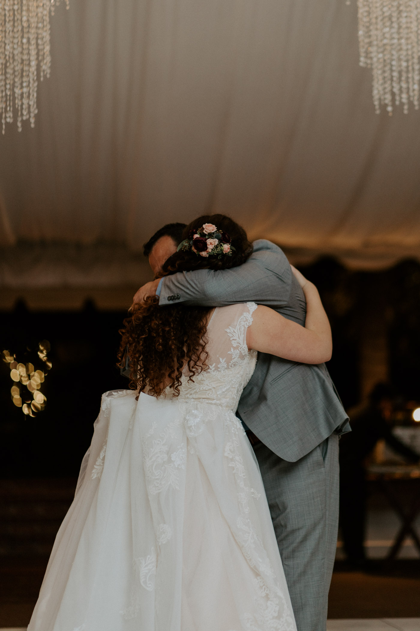 Bride hugging her father during their wedding reception
