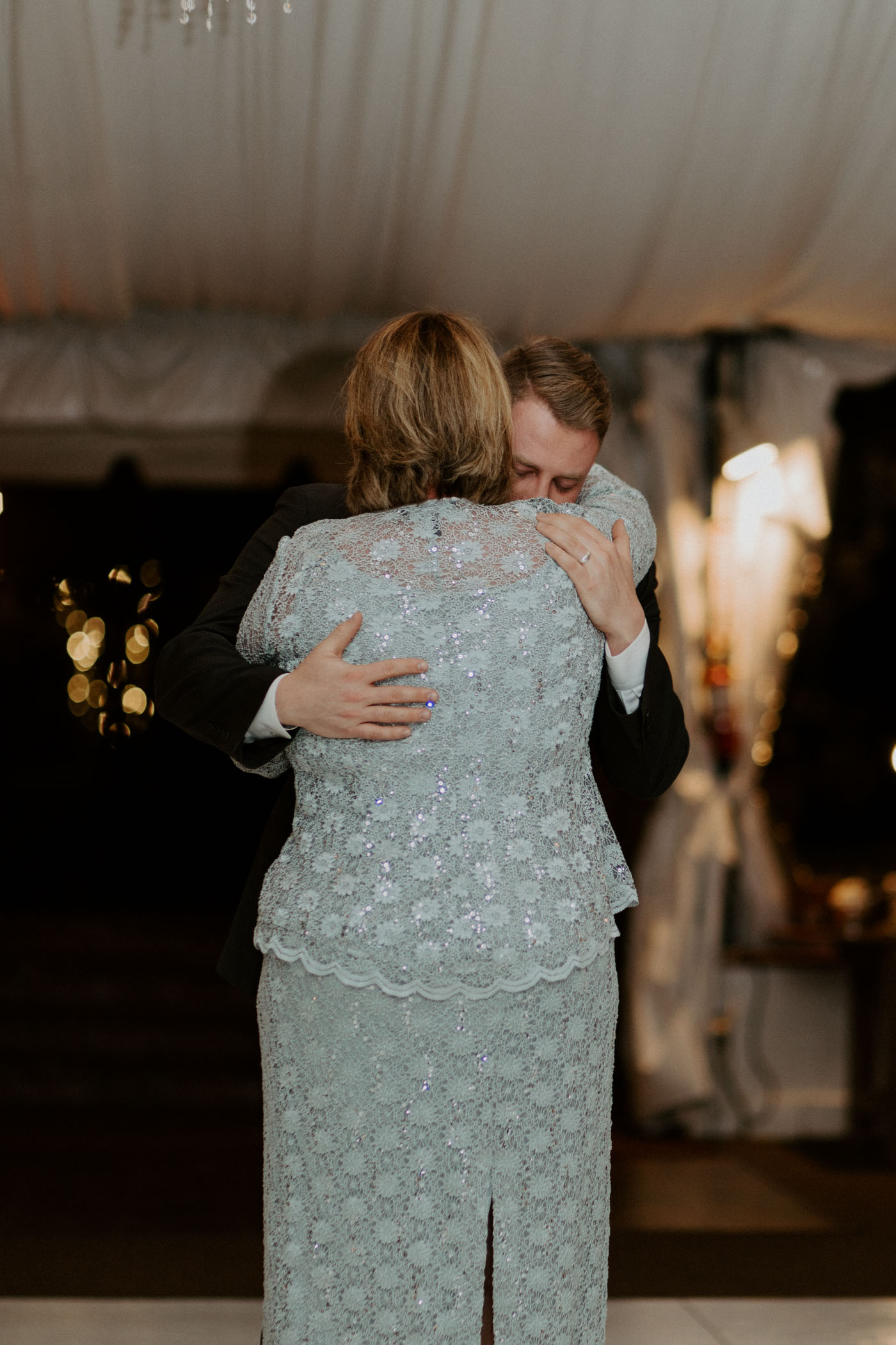 Mother son dance on wedding day with emotional mother